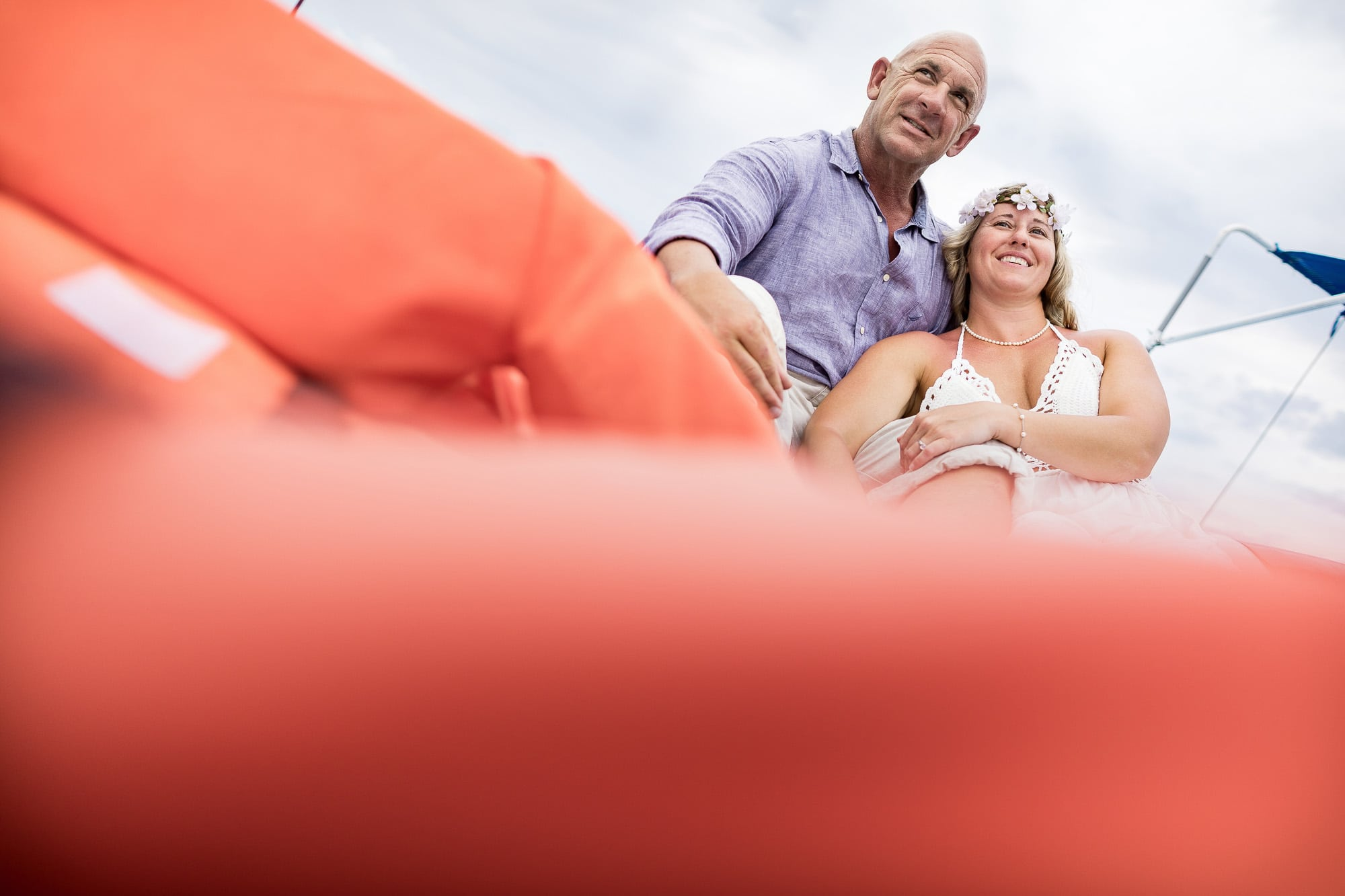 Closeup of destination wedding couple on the Blangala sailboat.