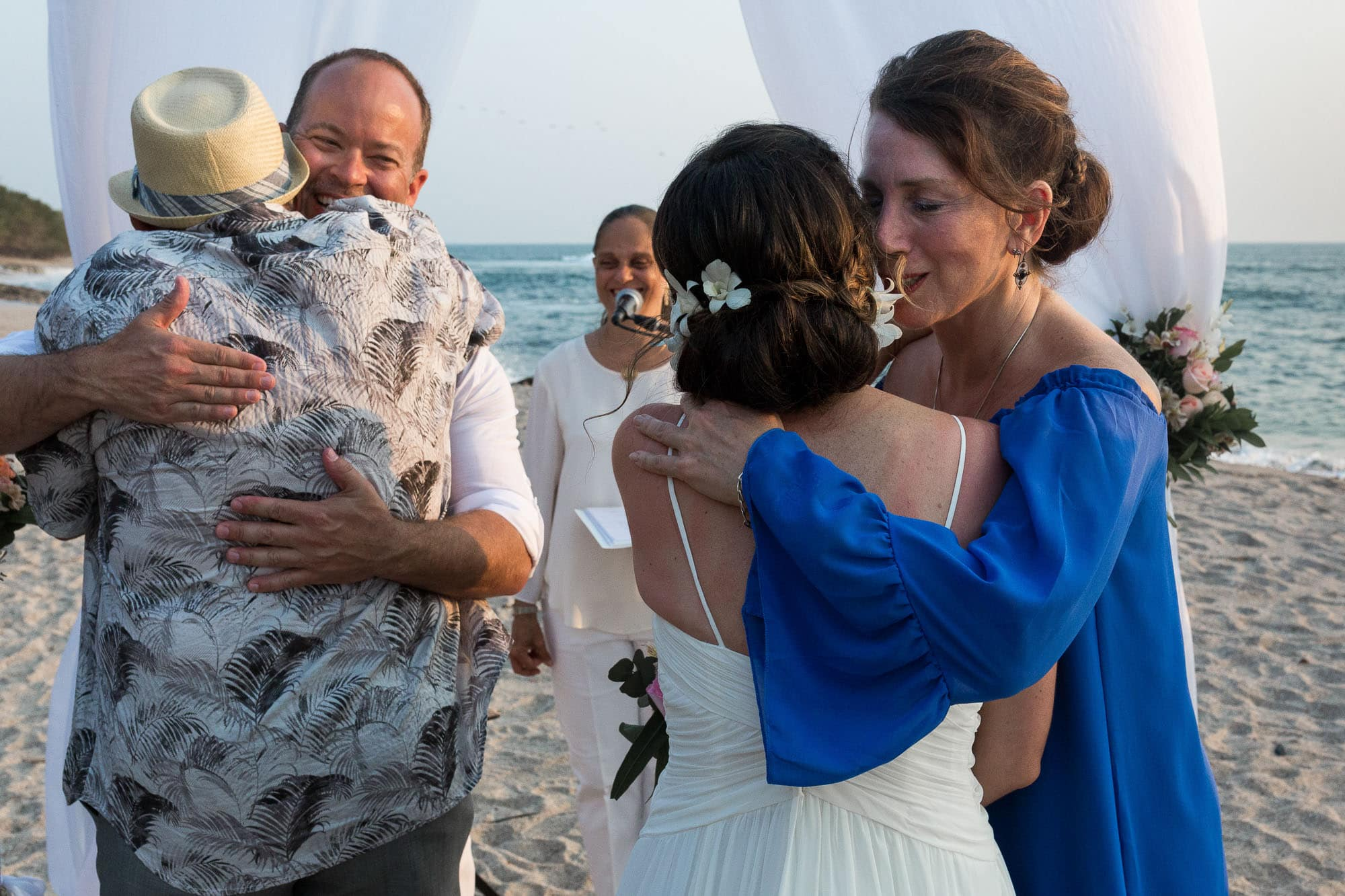 Bride and groom hugging the bride's parents