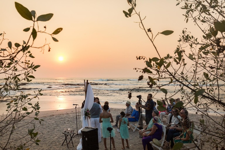 The picturesque ceremony on the beach at sunset.