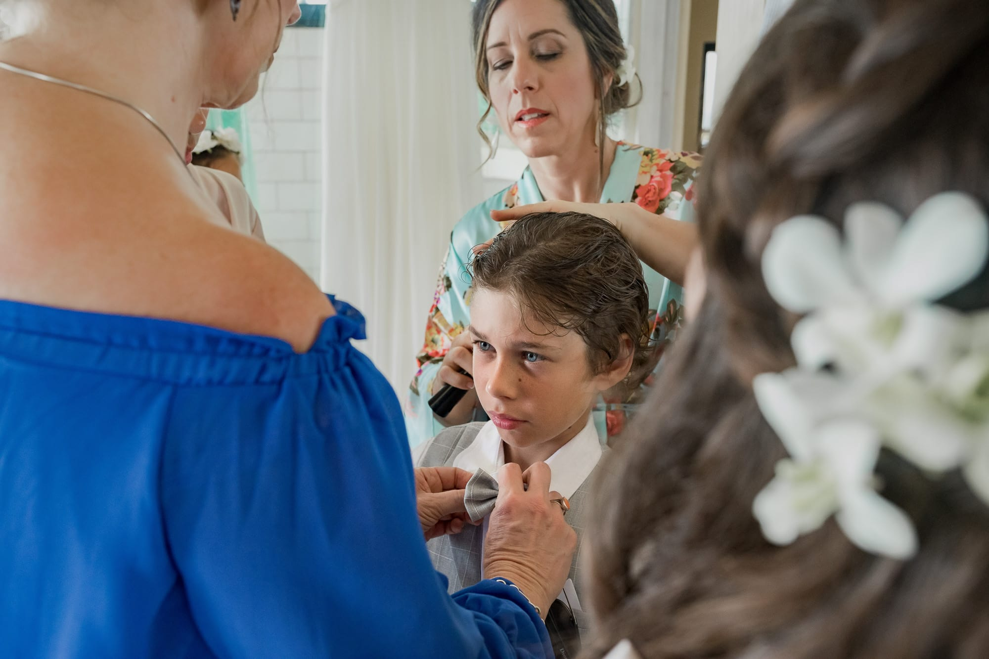 Bride getting son ready for her wedding-on-the-beach-Costa-Rica