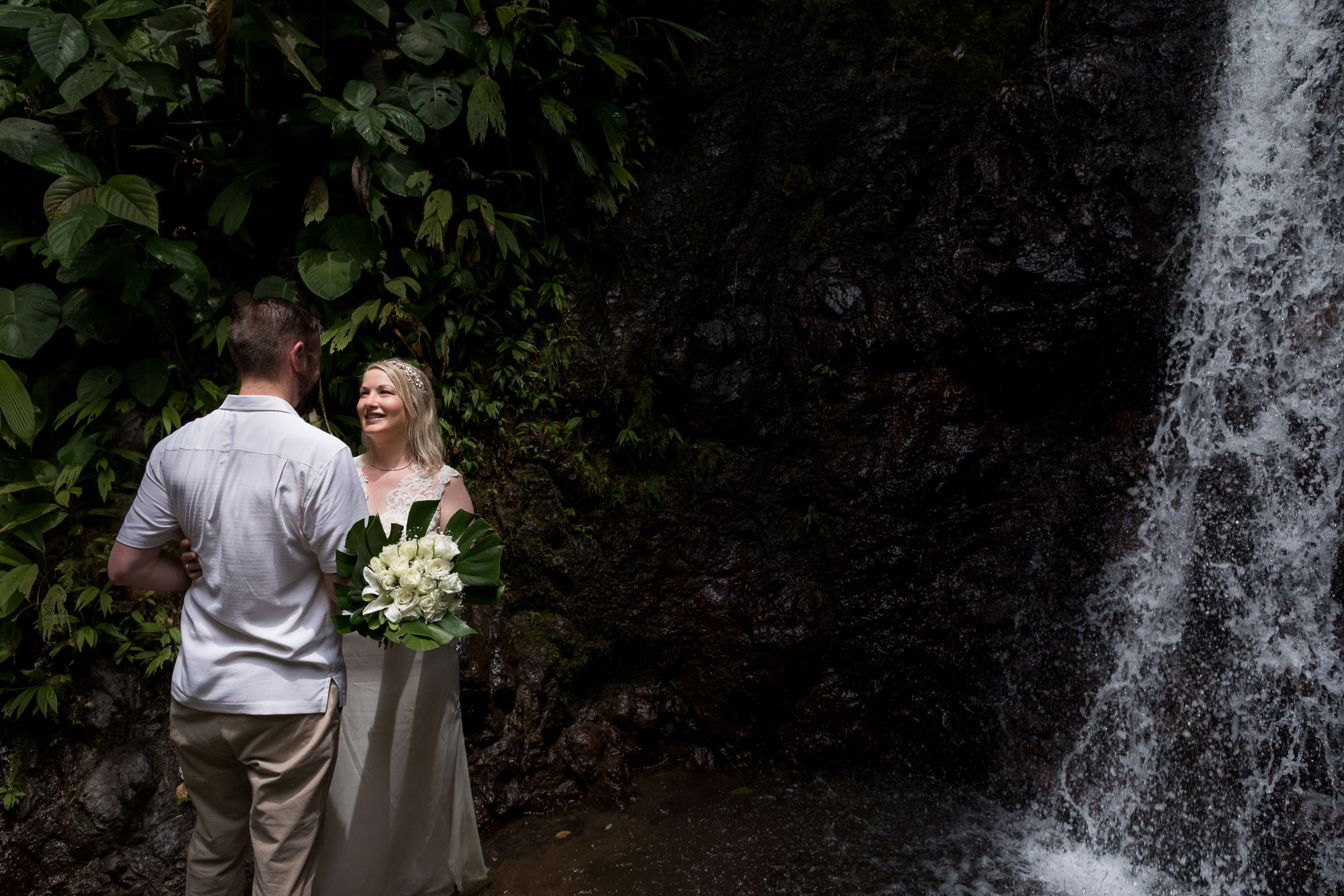 bride and groom with the waterfall