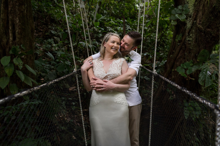 Forest Wedding - Bride and groom on suspension bridge in costa rican rainforest