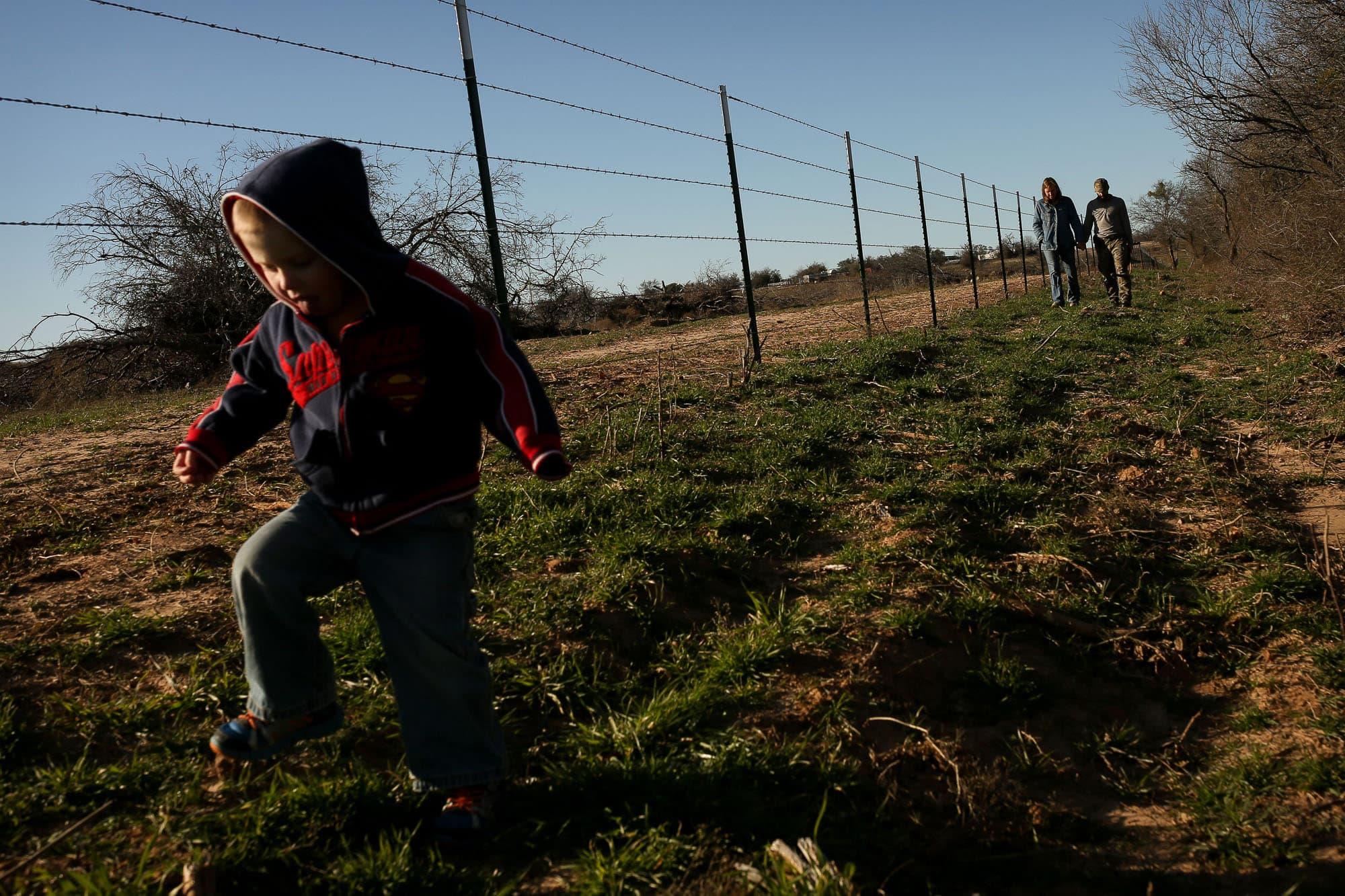 family takes a walk on their property