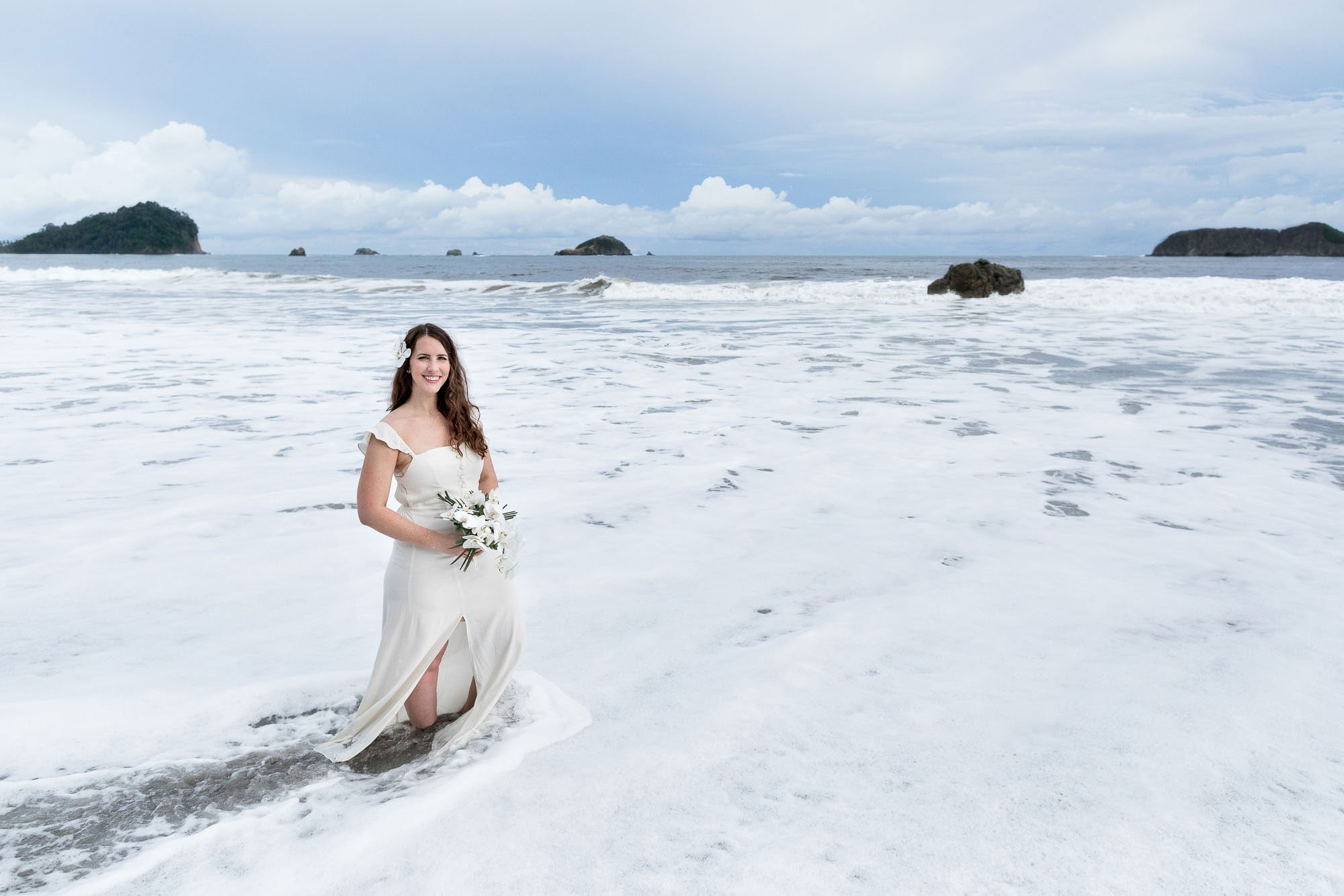 The bride posing in the waves after her beach elopement