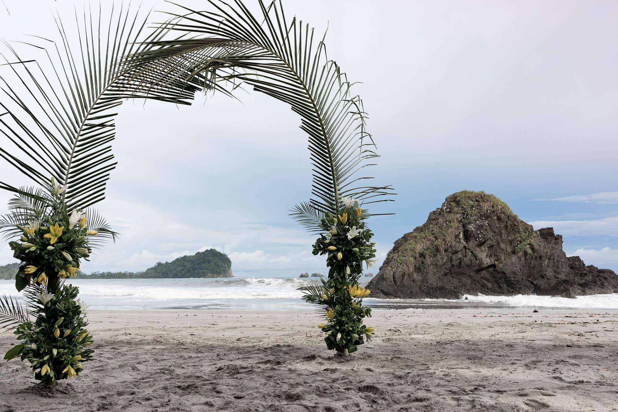 Epic palm frond and flower arbor on the beach
