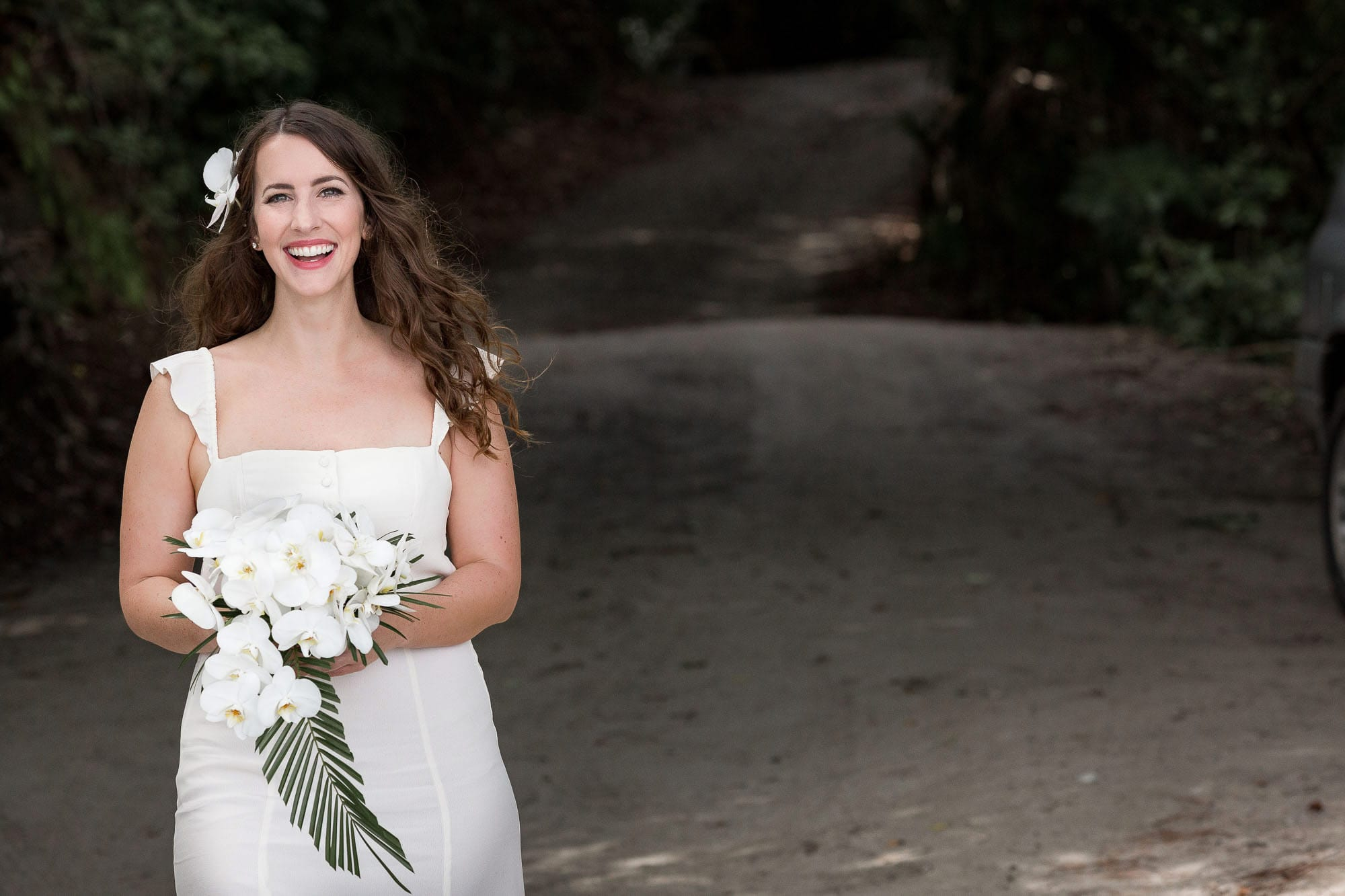 Happy bride in one of the best places to elope on earth!