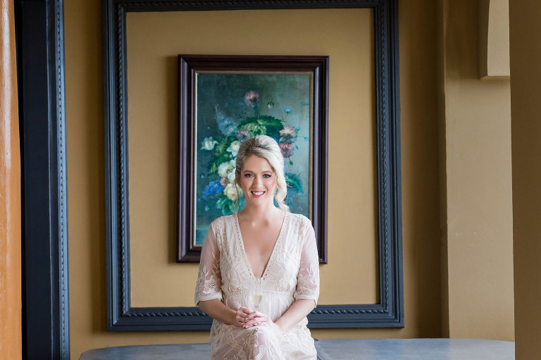 The bride framed by a frame within a frame