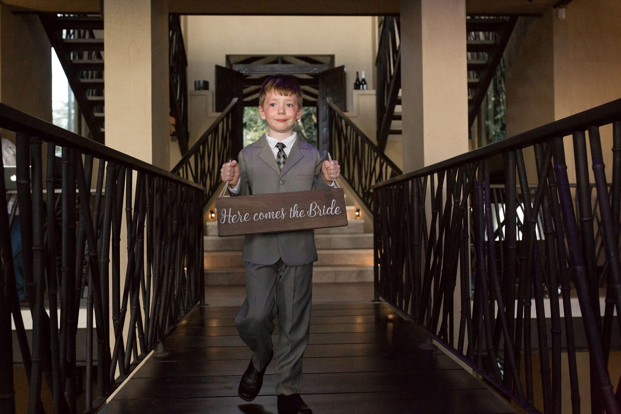 The ring bearer perfectly placed in a intricate staircase in Vista Hermosa