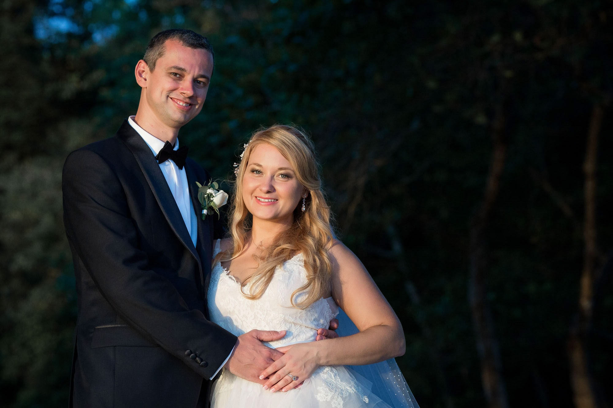 The happy bride and groom pose for a formal bridal portrait