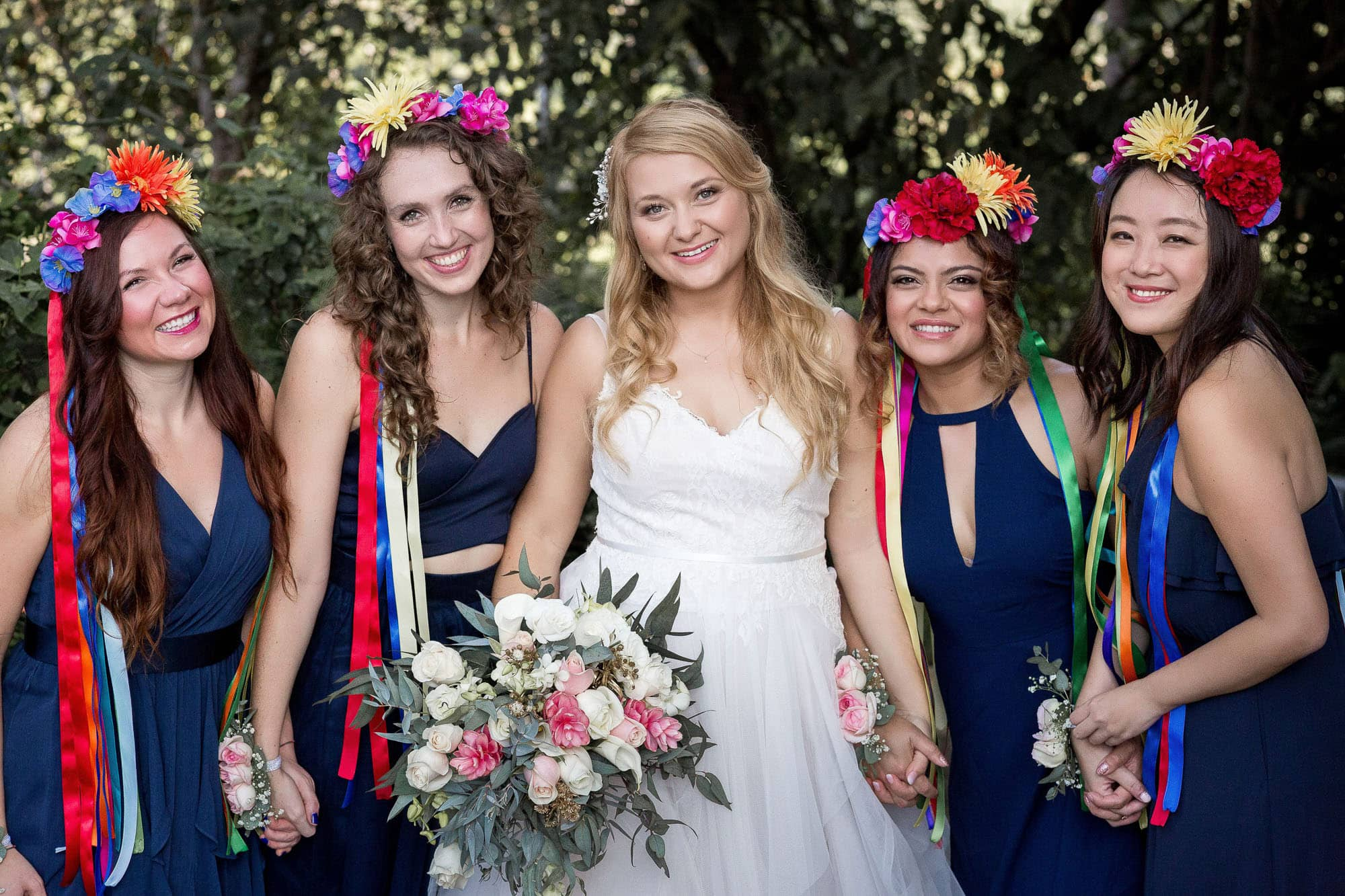The bride with her bridal party and their traditional wedding headpieces.