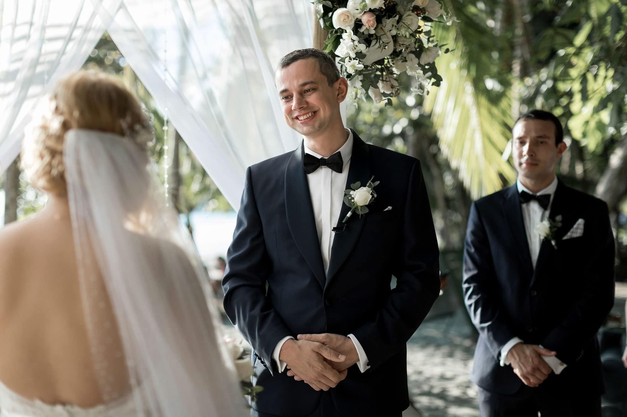 Pure happiness on the groom's face during the ceremony