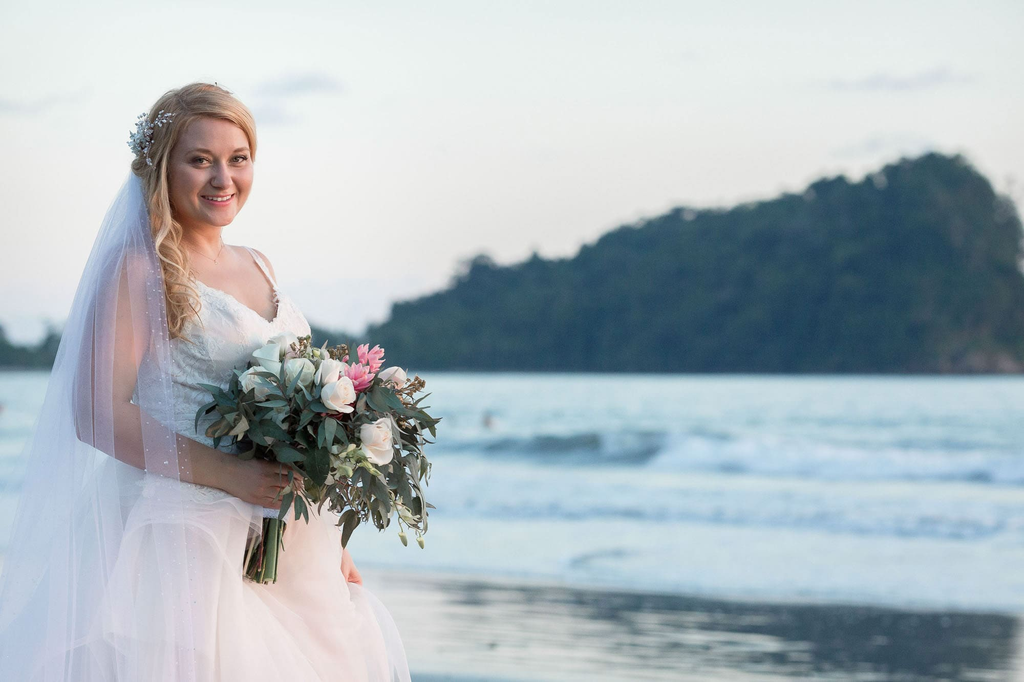 Traditional wedding portrait time! The bride on the beach