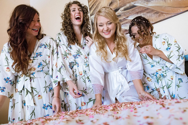 The bride and her girls having a blast while getting ready