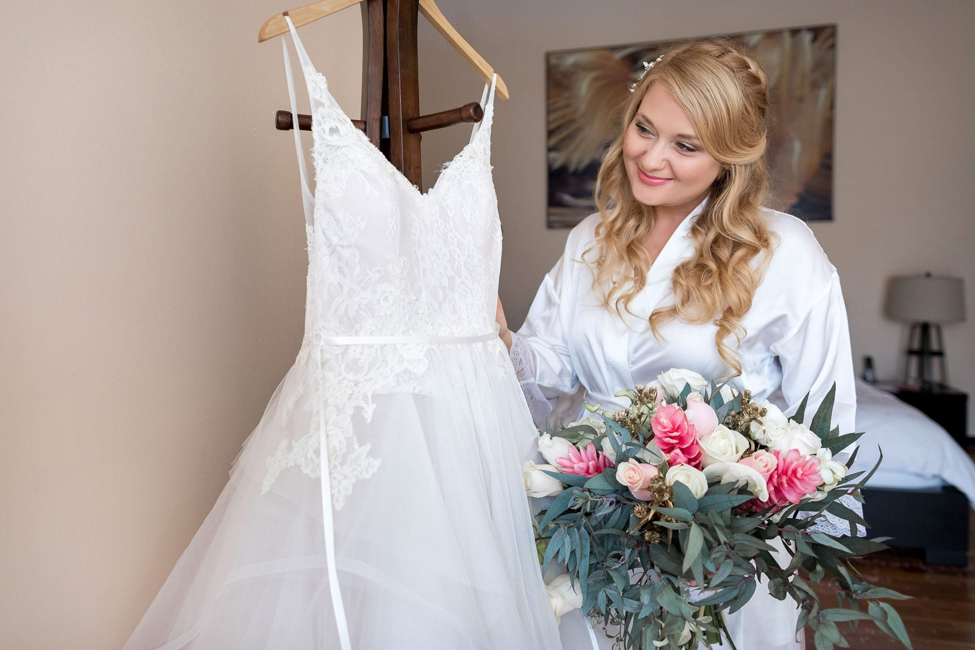 The bride with her dress and flowers