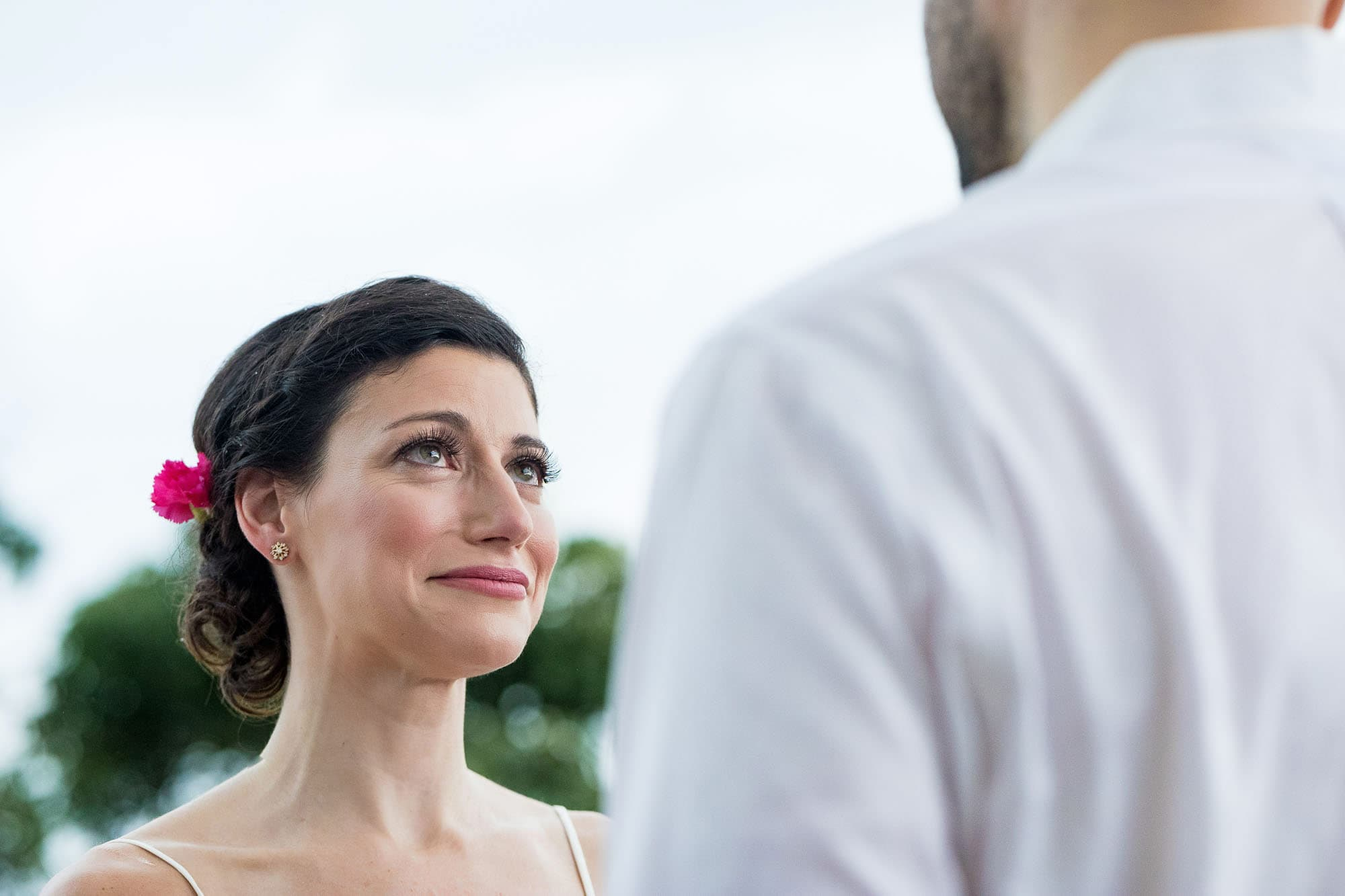 A poignant moment registers on the bride's face during the costa rica elopement ceremony