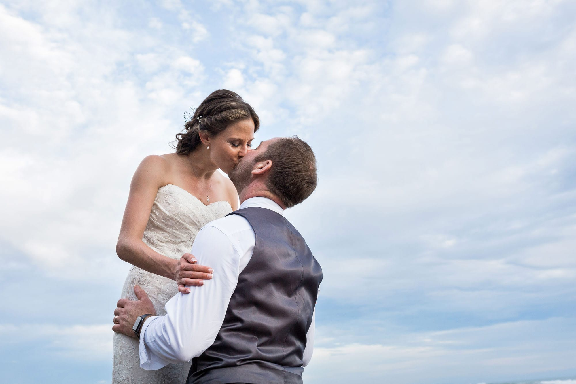 Even with a little rain on your wedding day there can be blue skies for the bridal portraits!