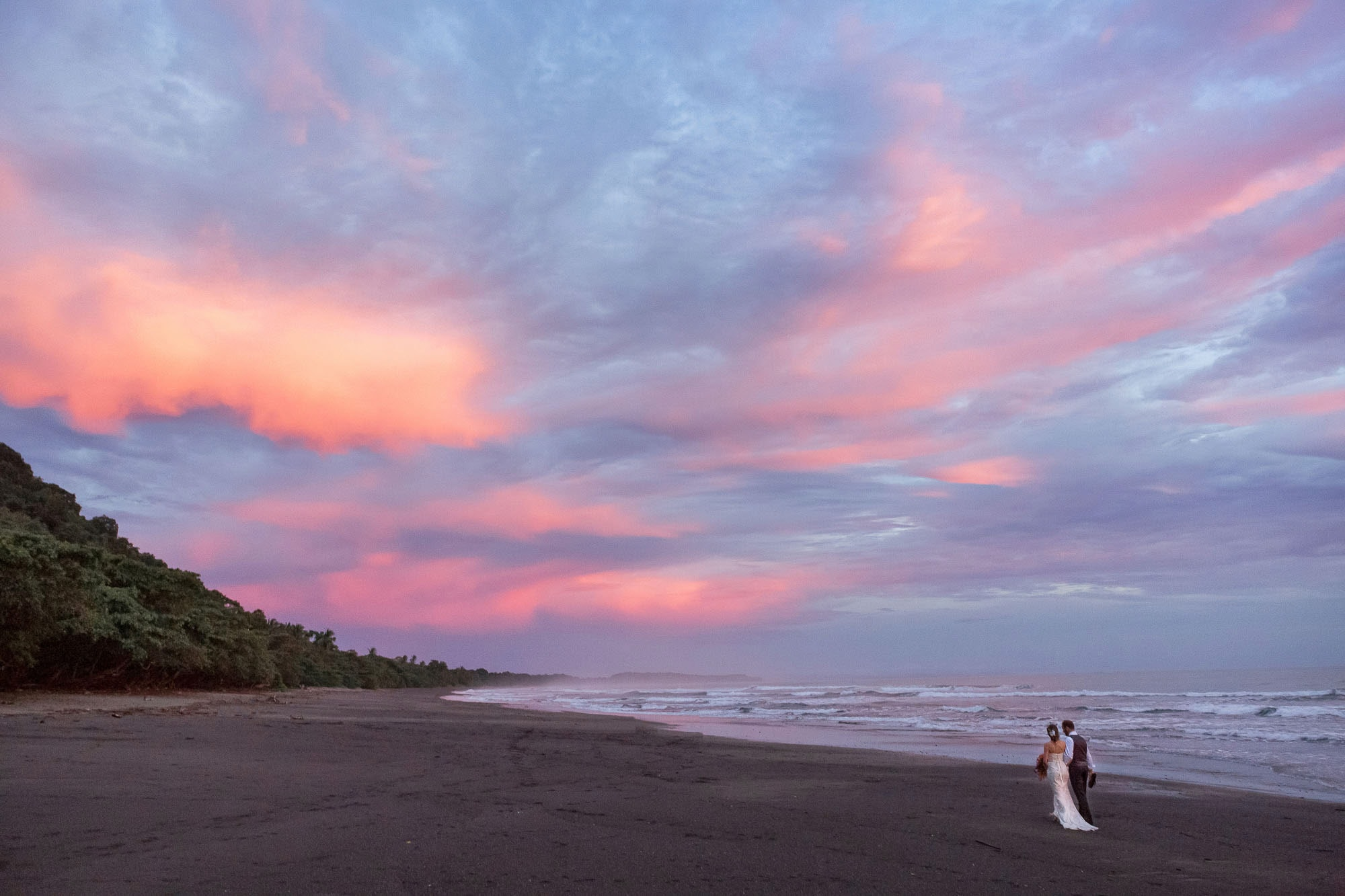 Cotton candy skies with a little rain on wedding day.