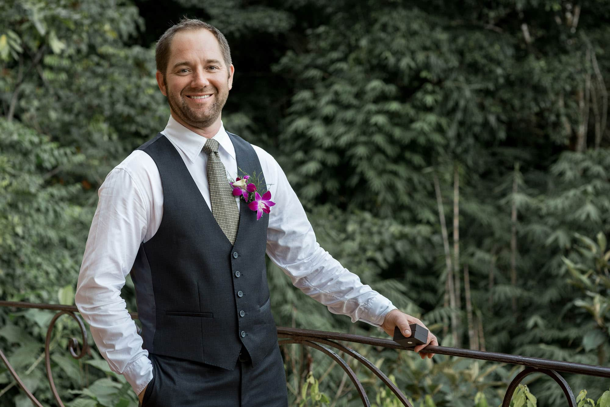 Rain on your wedding day isn't dampening this smile! The groom before the ceremony.