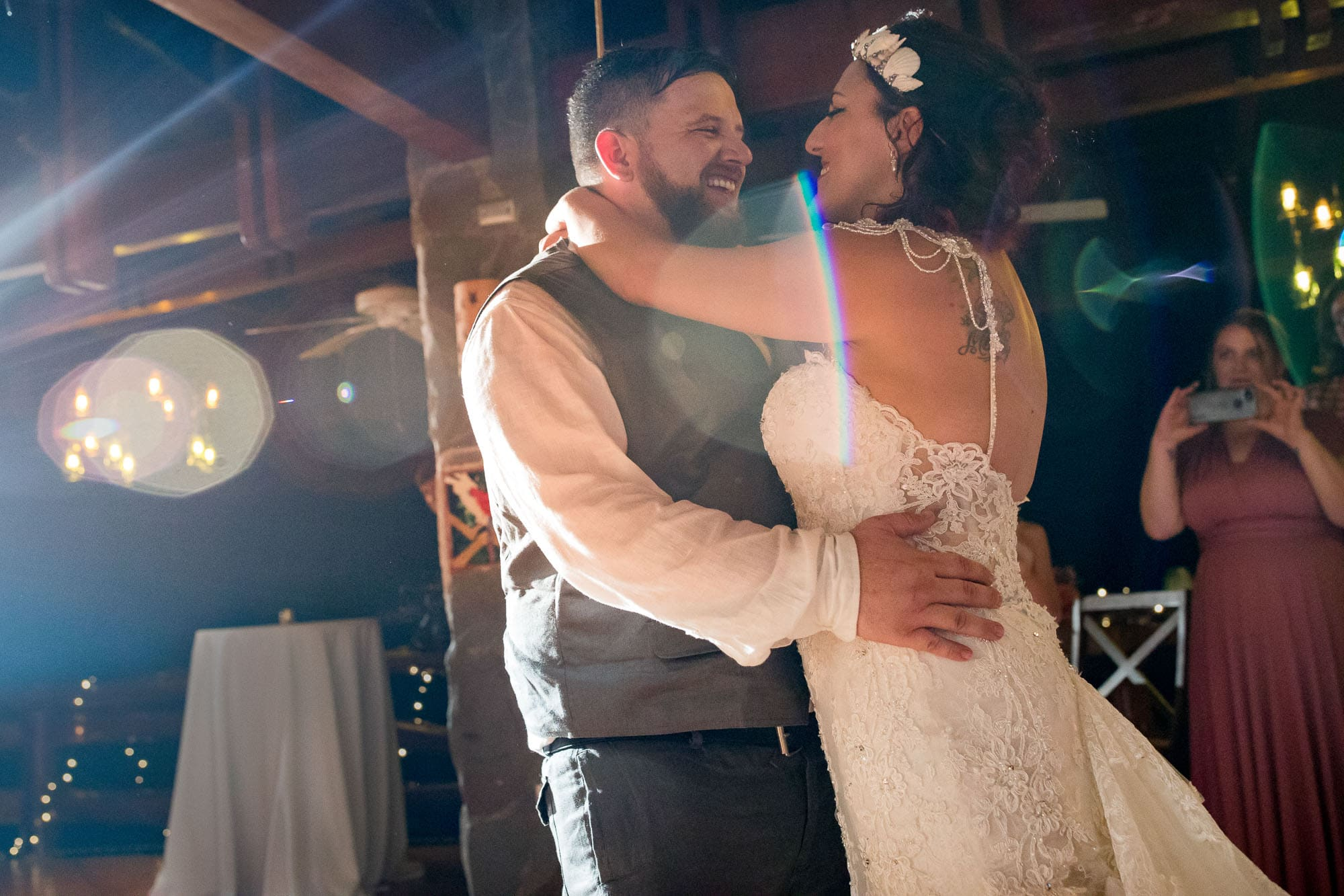 Love blooms as the bride and groom dance together