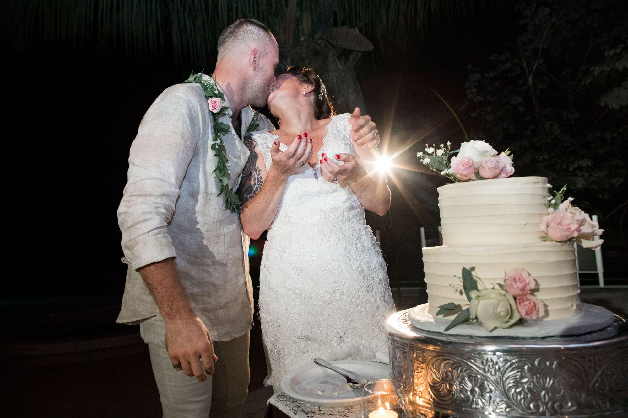Cutting the cake and sharing a kiss
