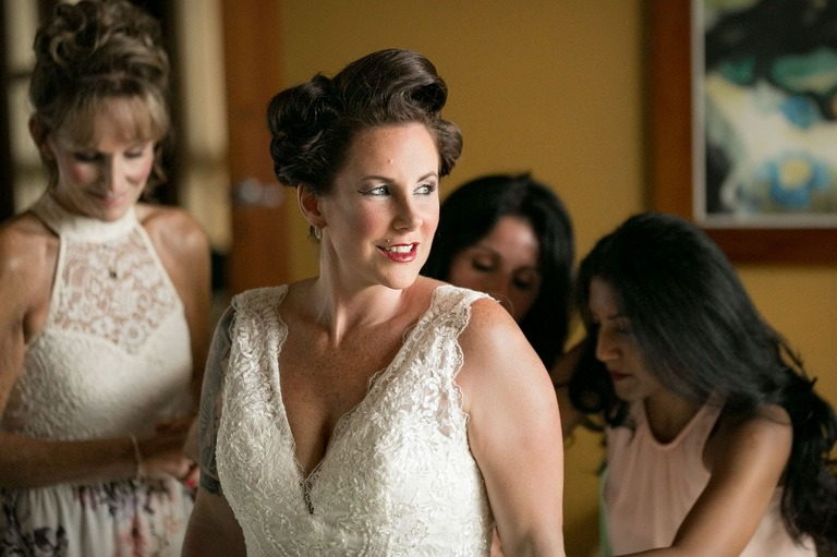 Bride getting ready before her emotional wedding