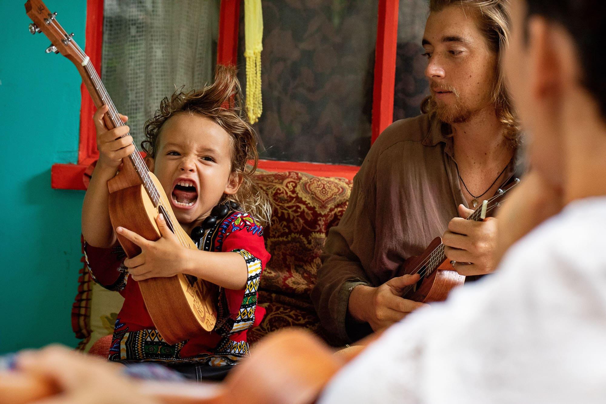 kid with uku ukulele