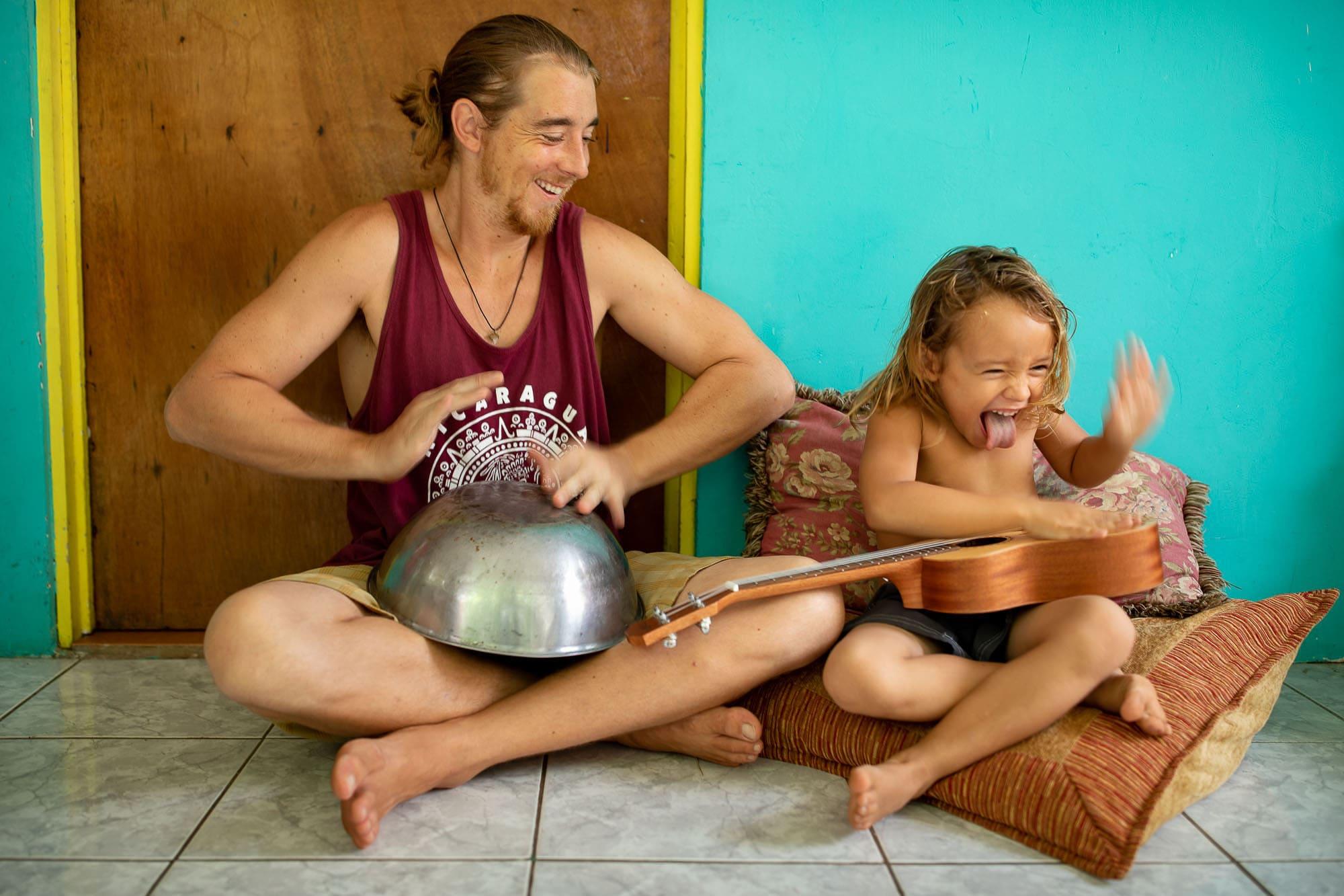 kid with uku ukulele with his father