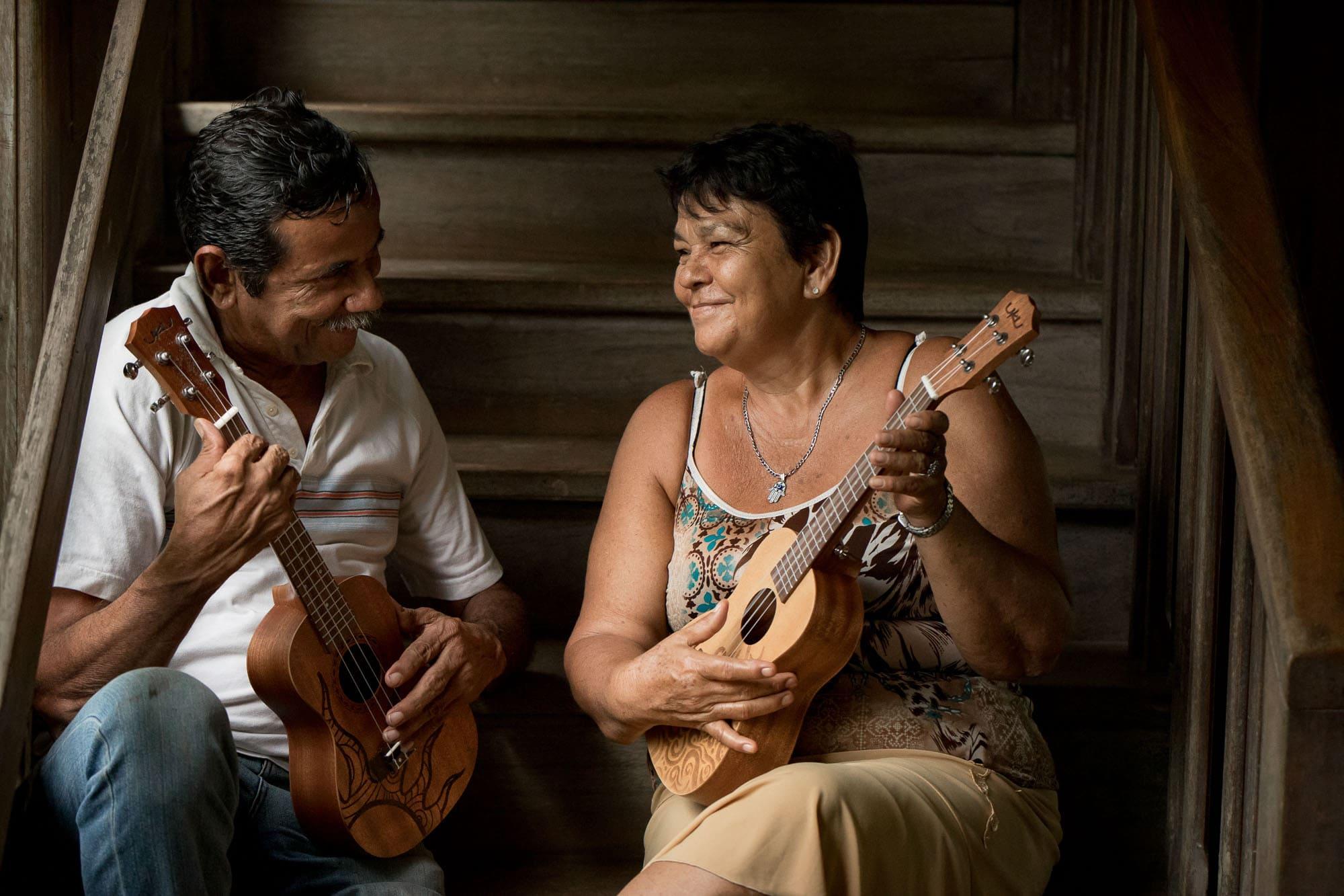 older couple playing ukulele
