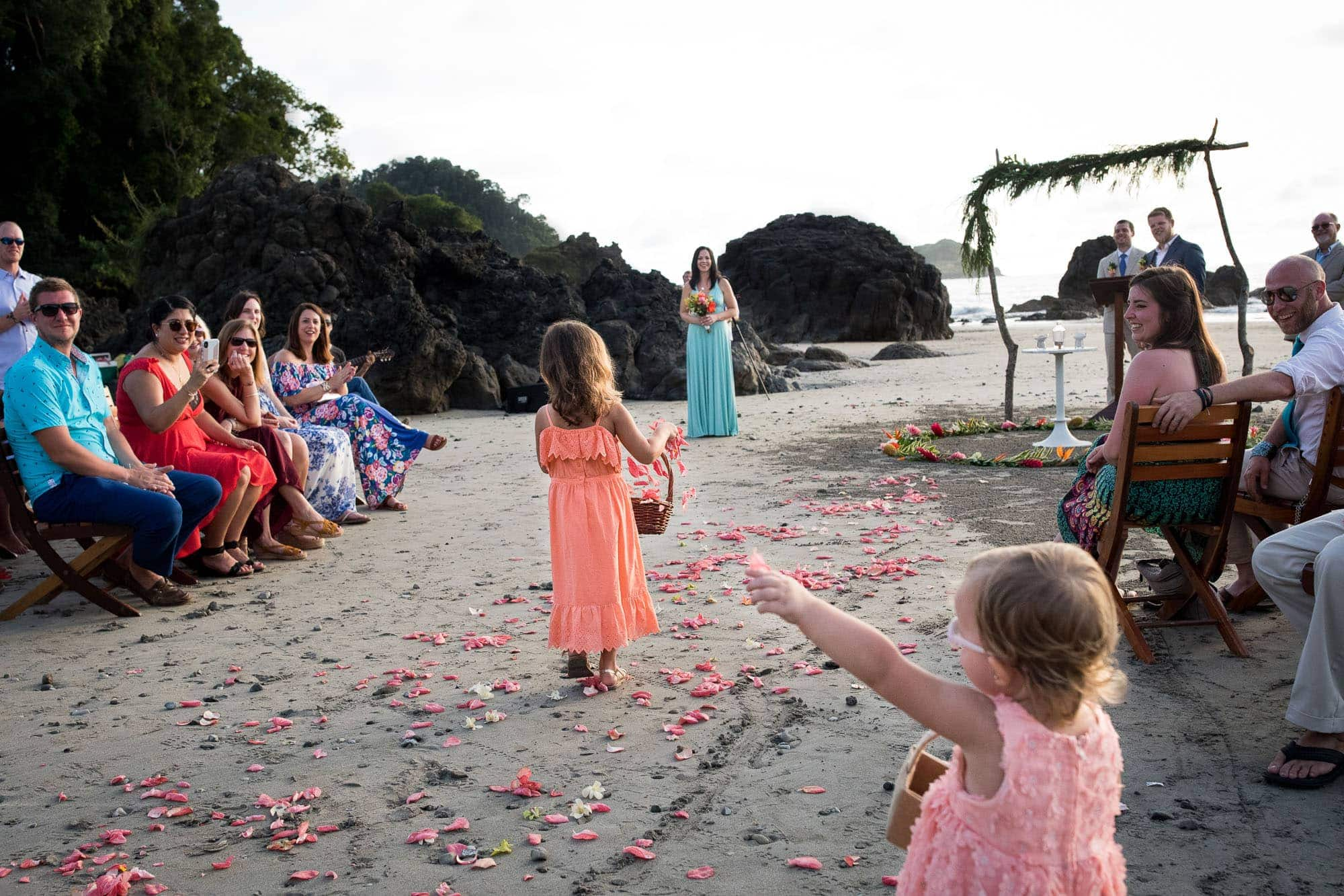 The flower girl leading the way with pretty pink petals