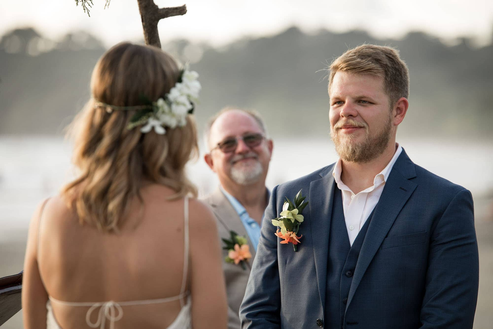 The groom with his dad behind him