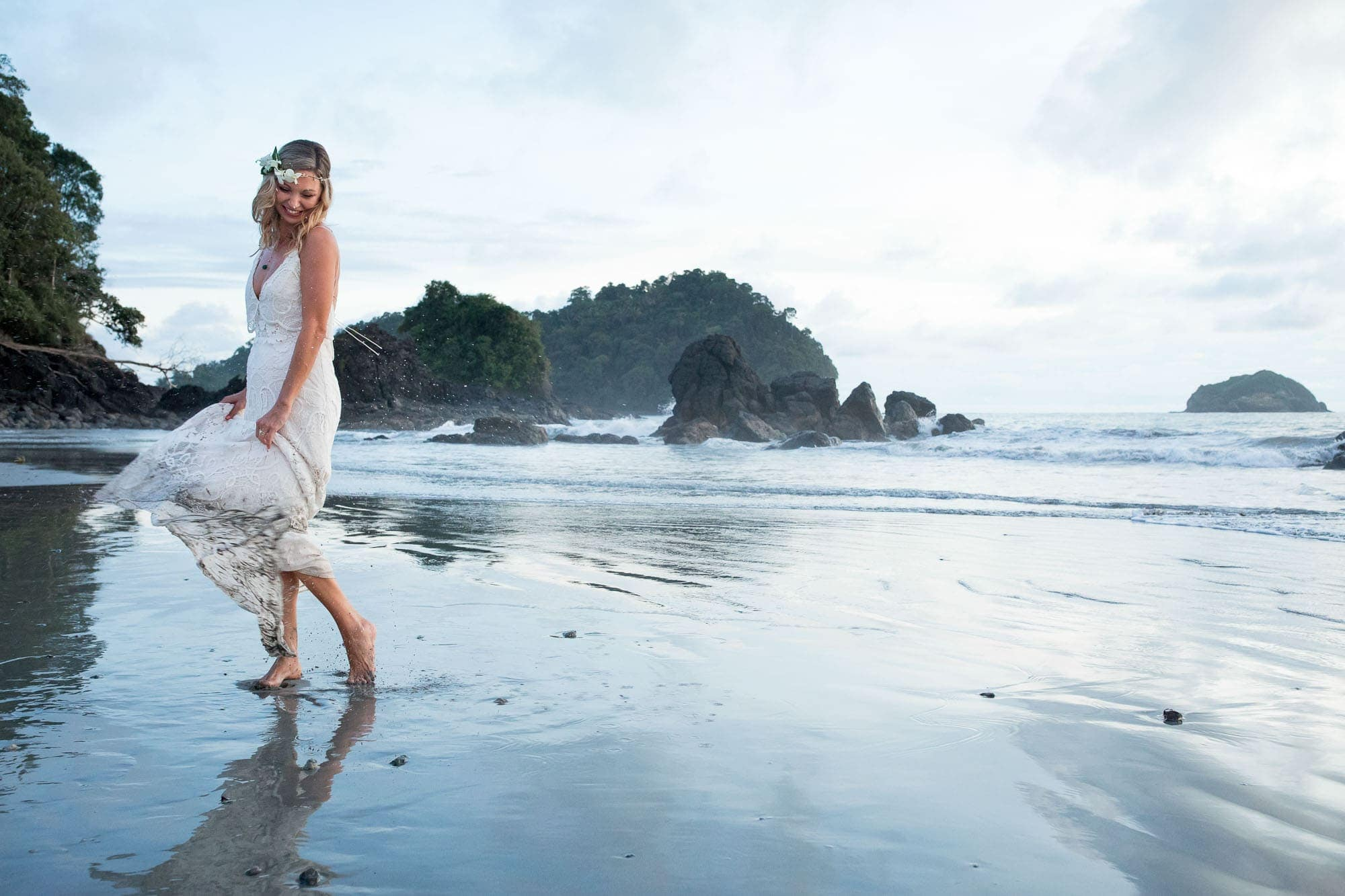 The bride playing on the beach