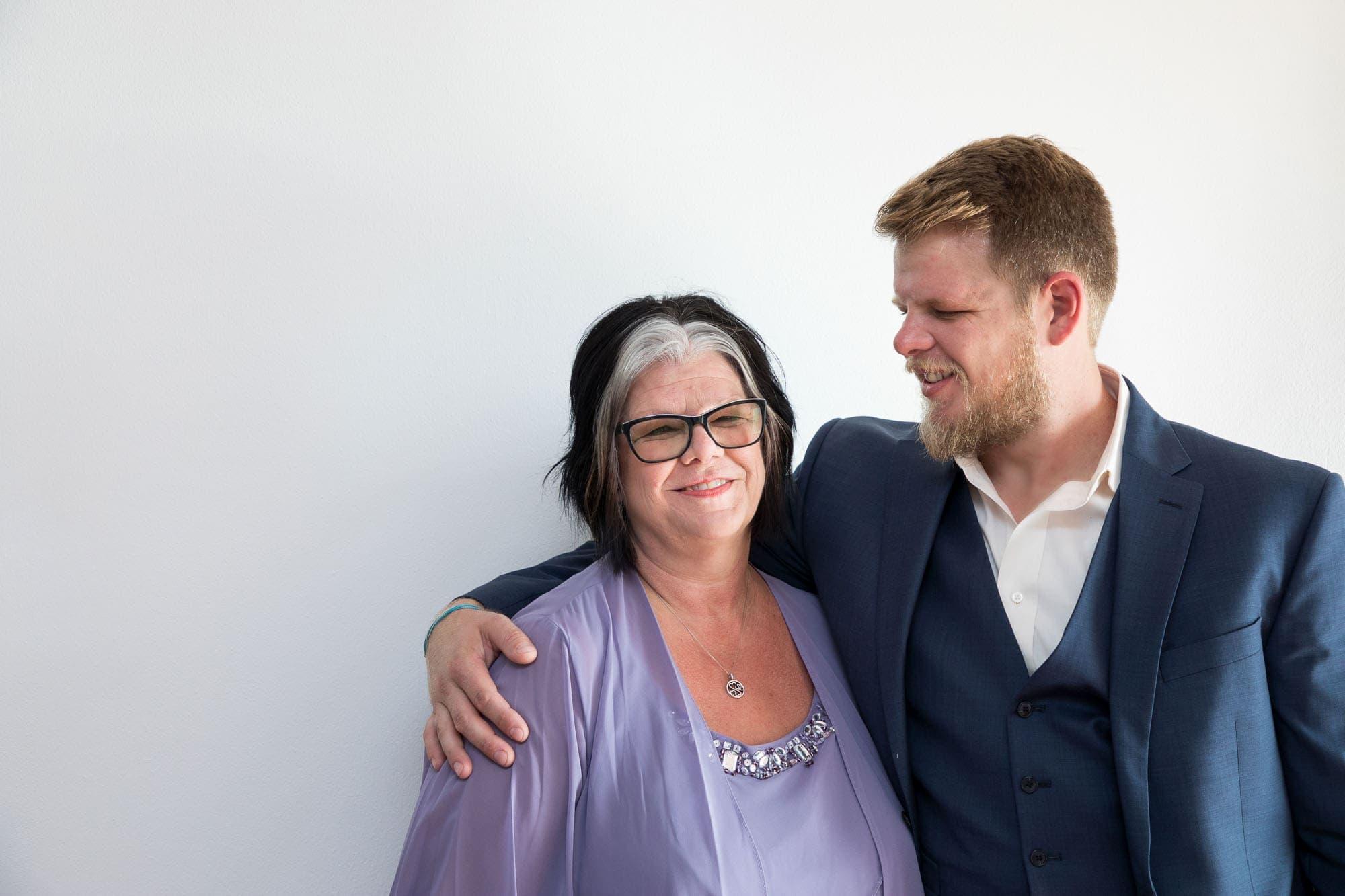 The groom with his mom before the joyful wedding ceremony