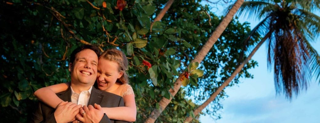 Bride and groom shot with a unique angle in the jungle