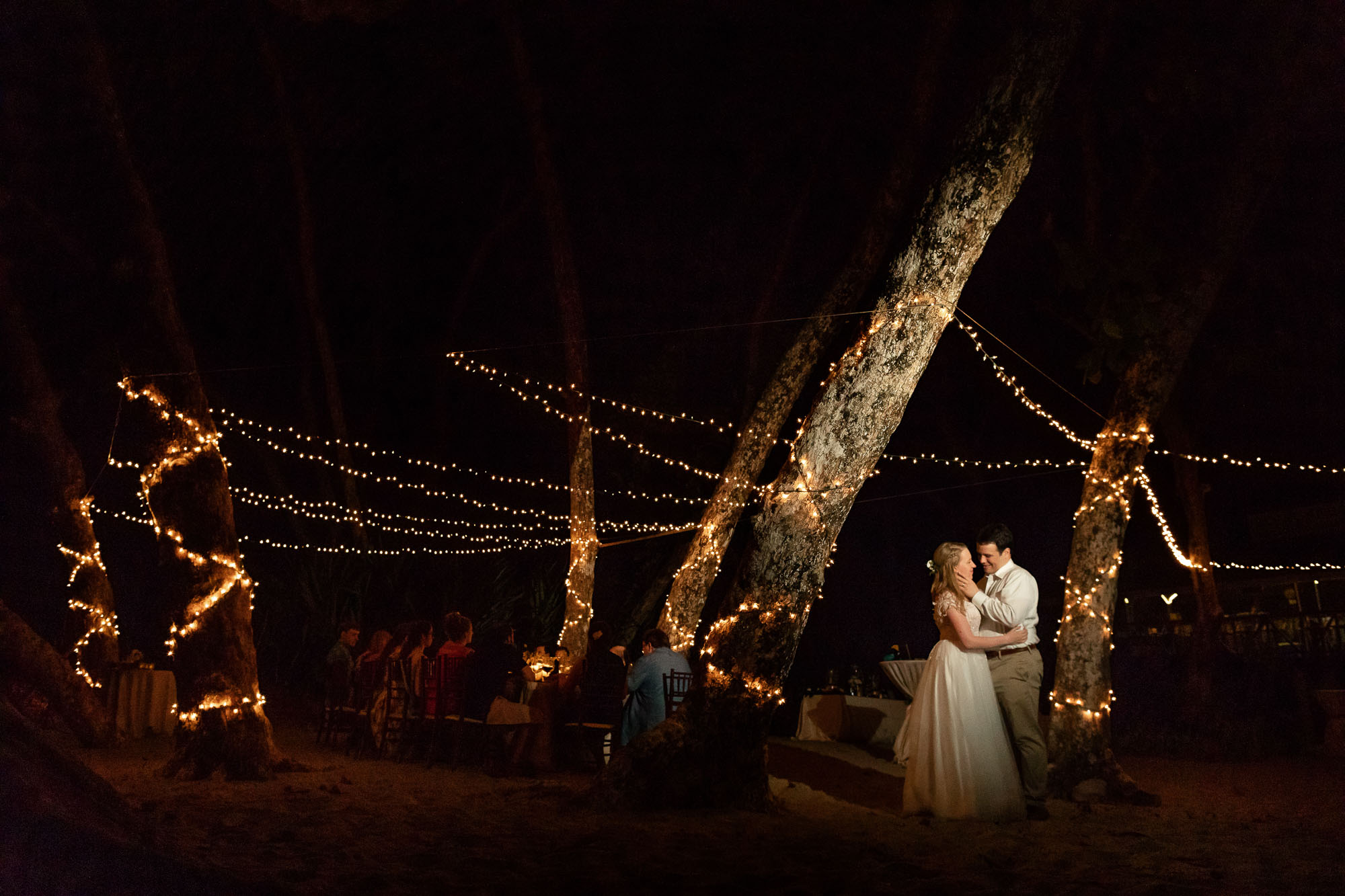 Creative wedding photography: spotlight on the couple surrounded by fairy lights