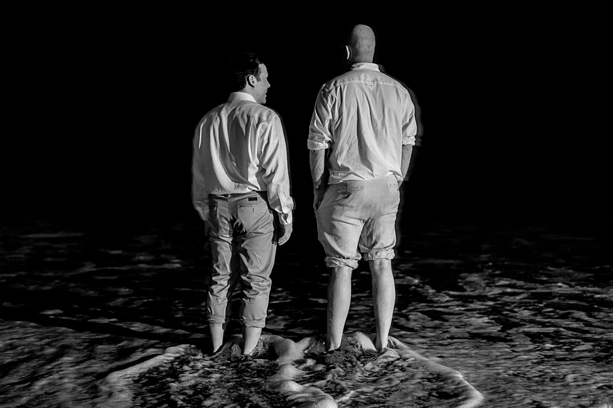 The groom and his friend enjoying a moment in the ocean