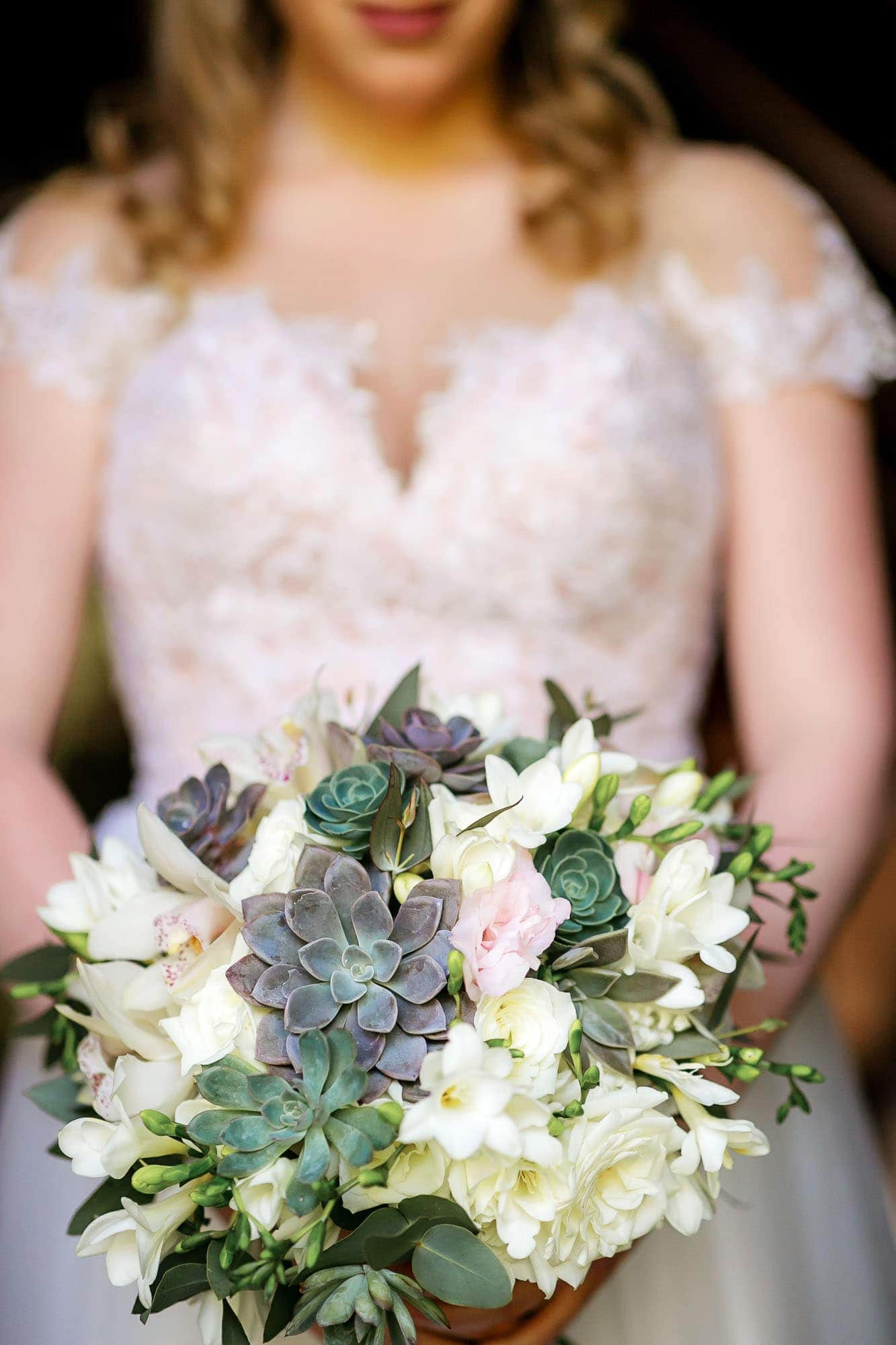 Closeup of the bride's unique bouquet in her hands