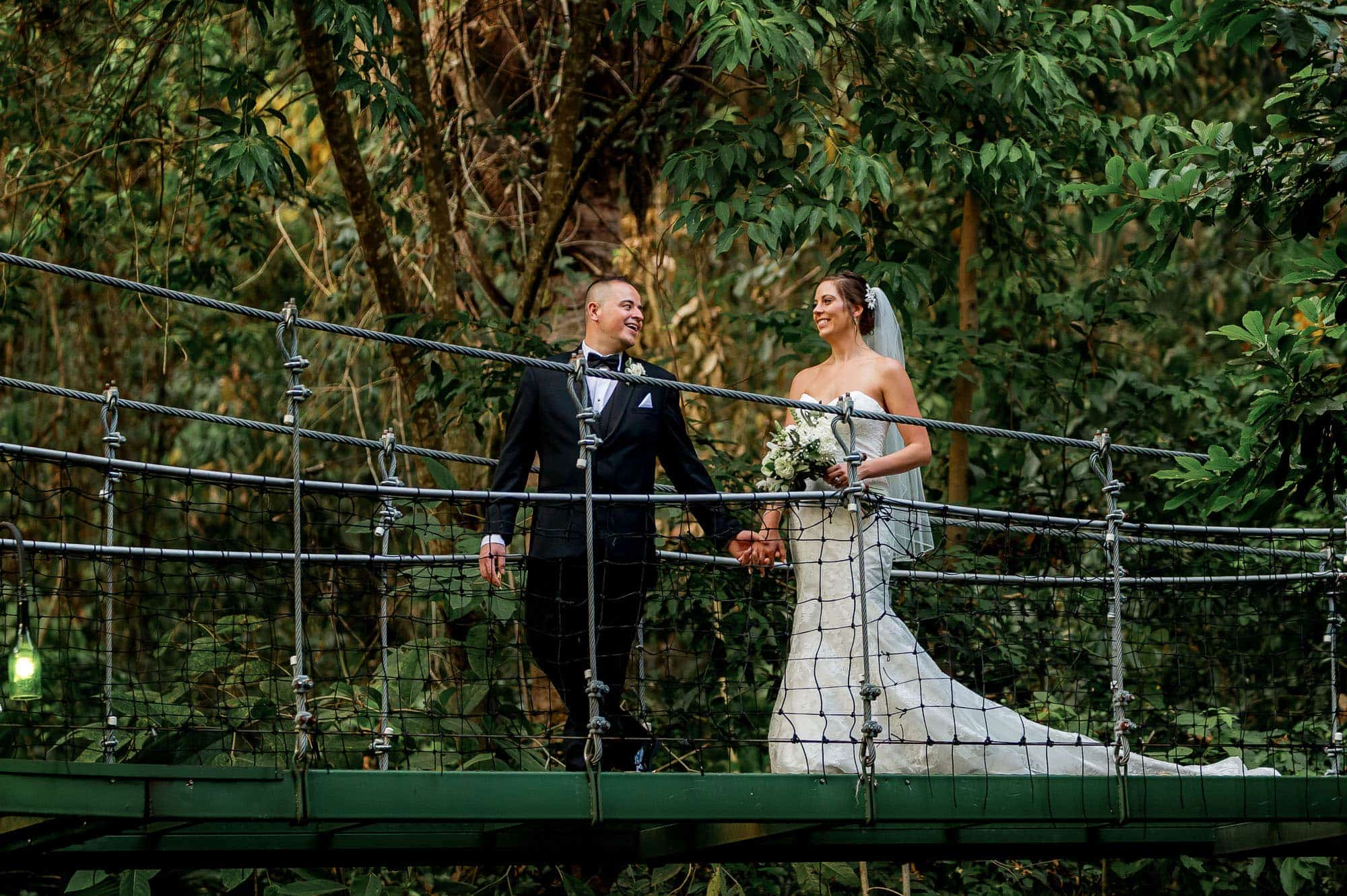 The bride and groom on the hanging bridge at Costa Verde