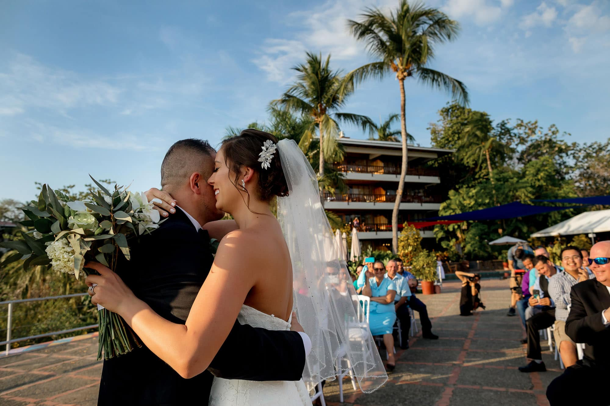 The bride and groom share a hug on the helipad at Costa Verde