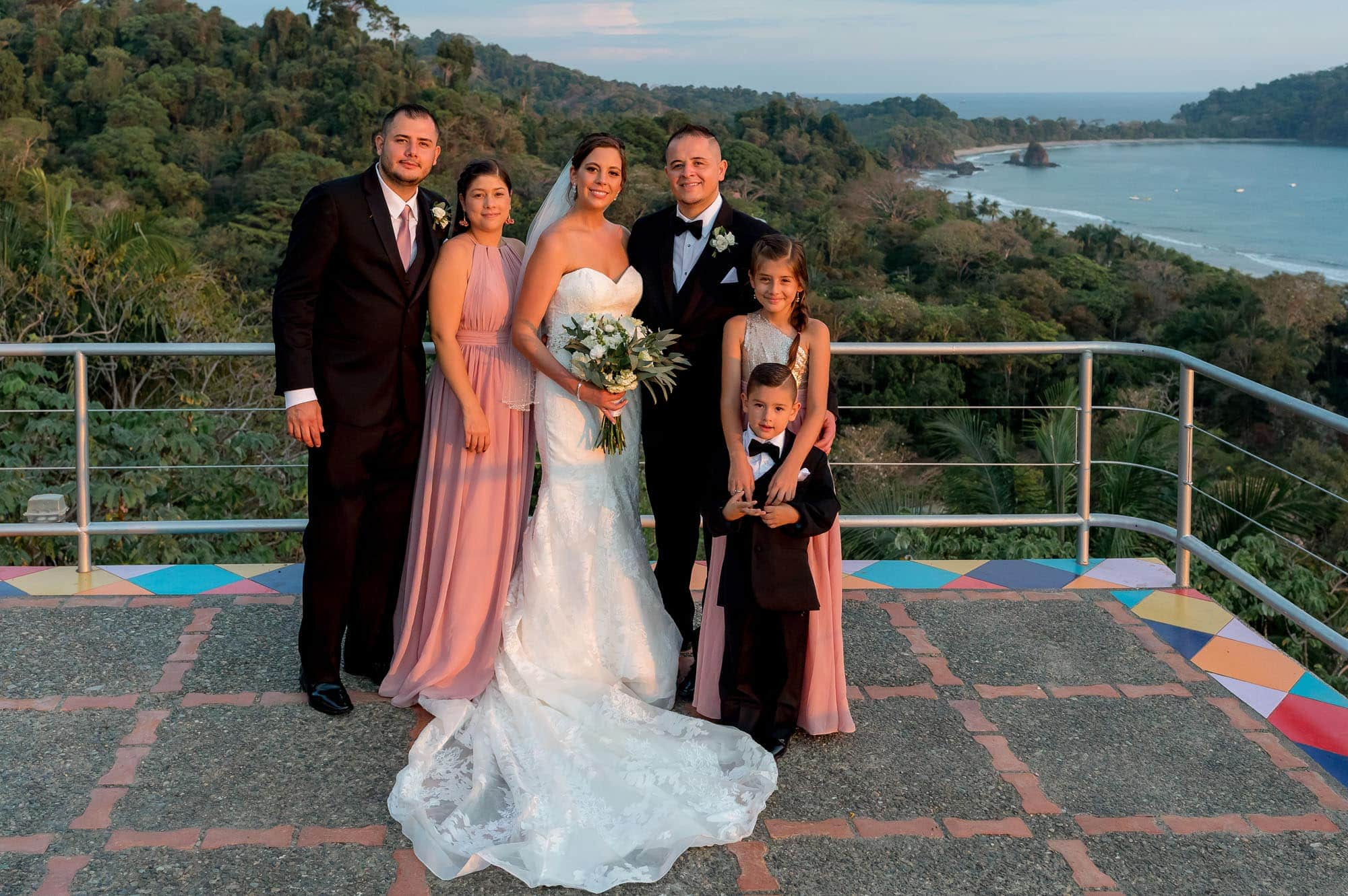 Formal wedding portrait of the bride and groom with family