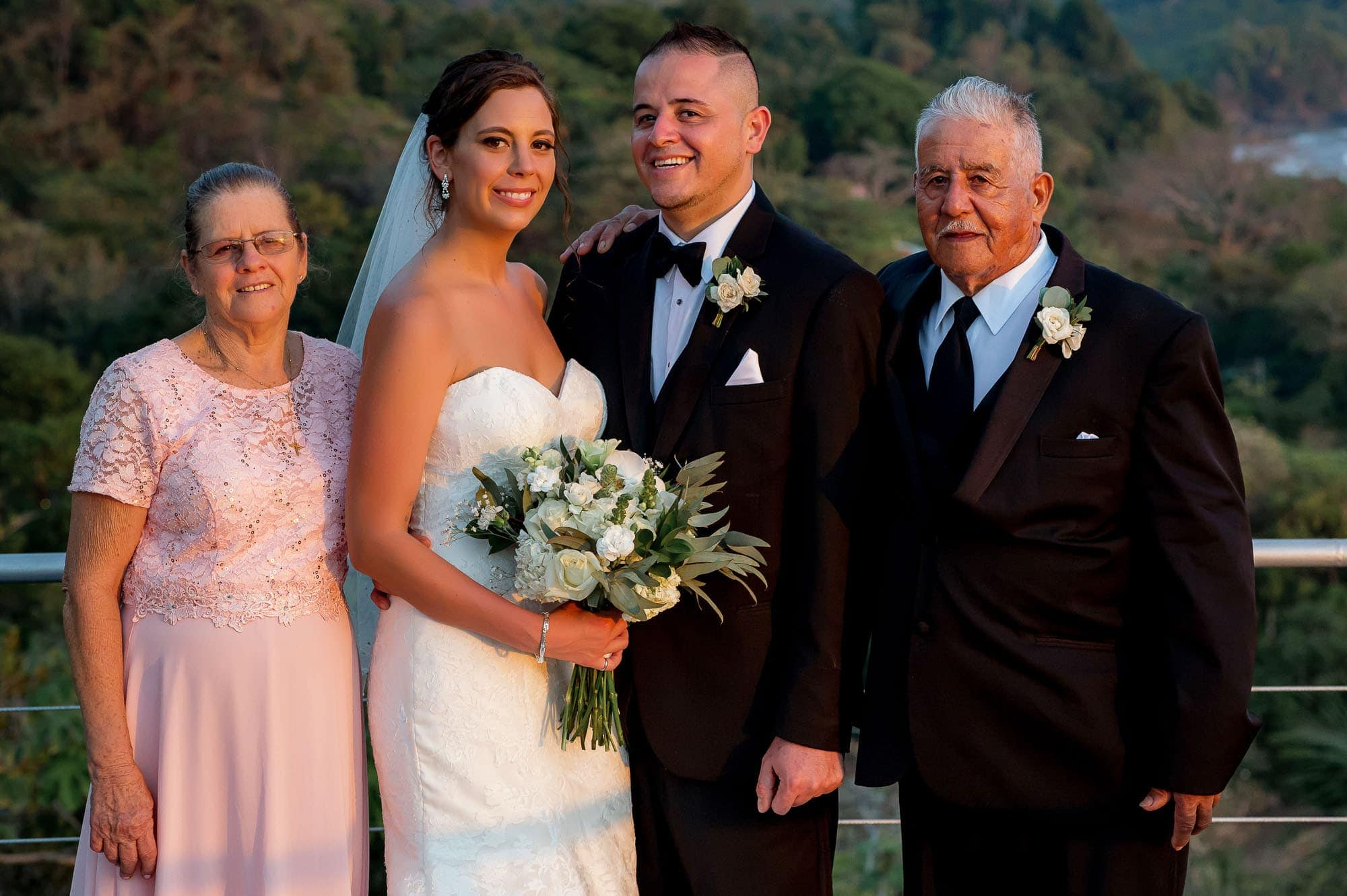 Formal wedding portrait of the bride and groom with groom's parents