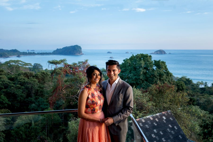 The bride and groom pose with the view