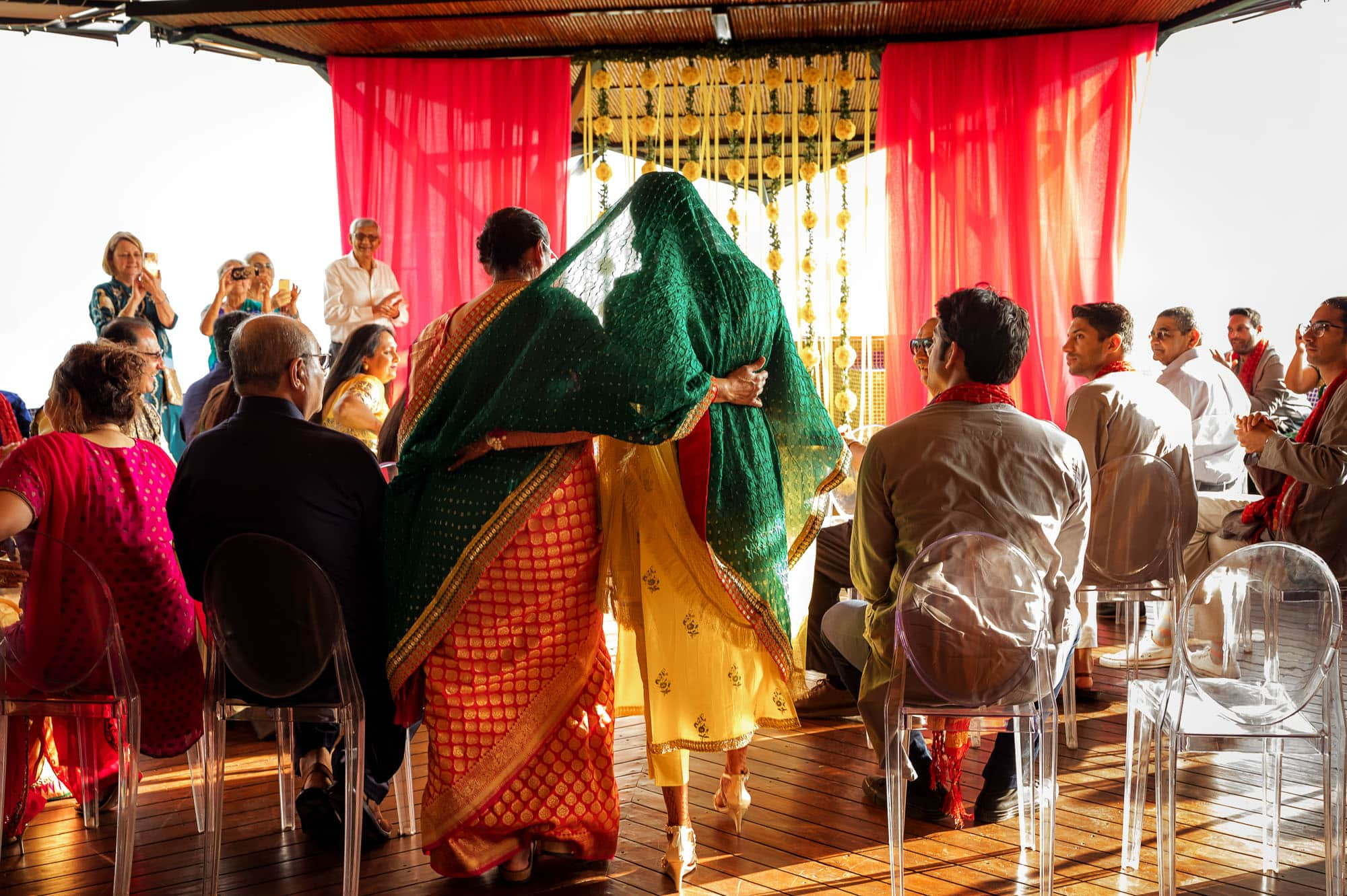 Escorting the bride in for the Pithi ceremony