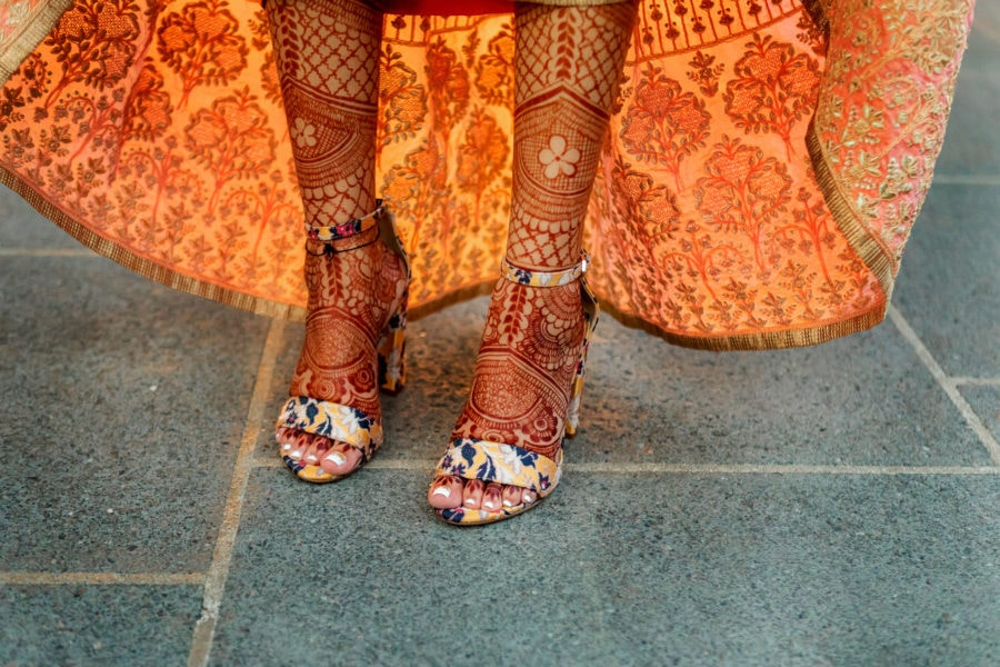 The bride showing off the wedding henna on her legs