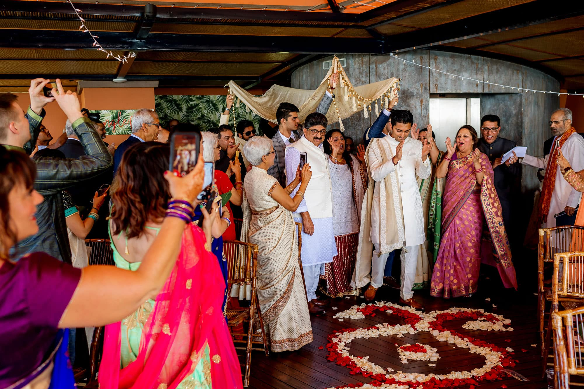 The groom enters amid much rejoicing
