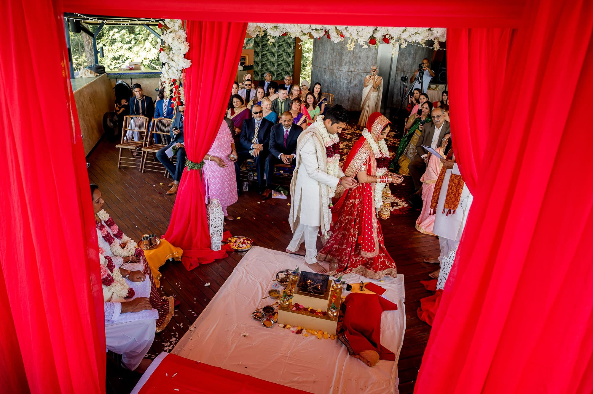 The bride and groom going around the fire as part of a traditional Hindu Muslim ceremony