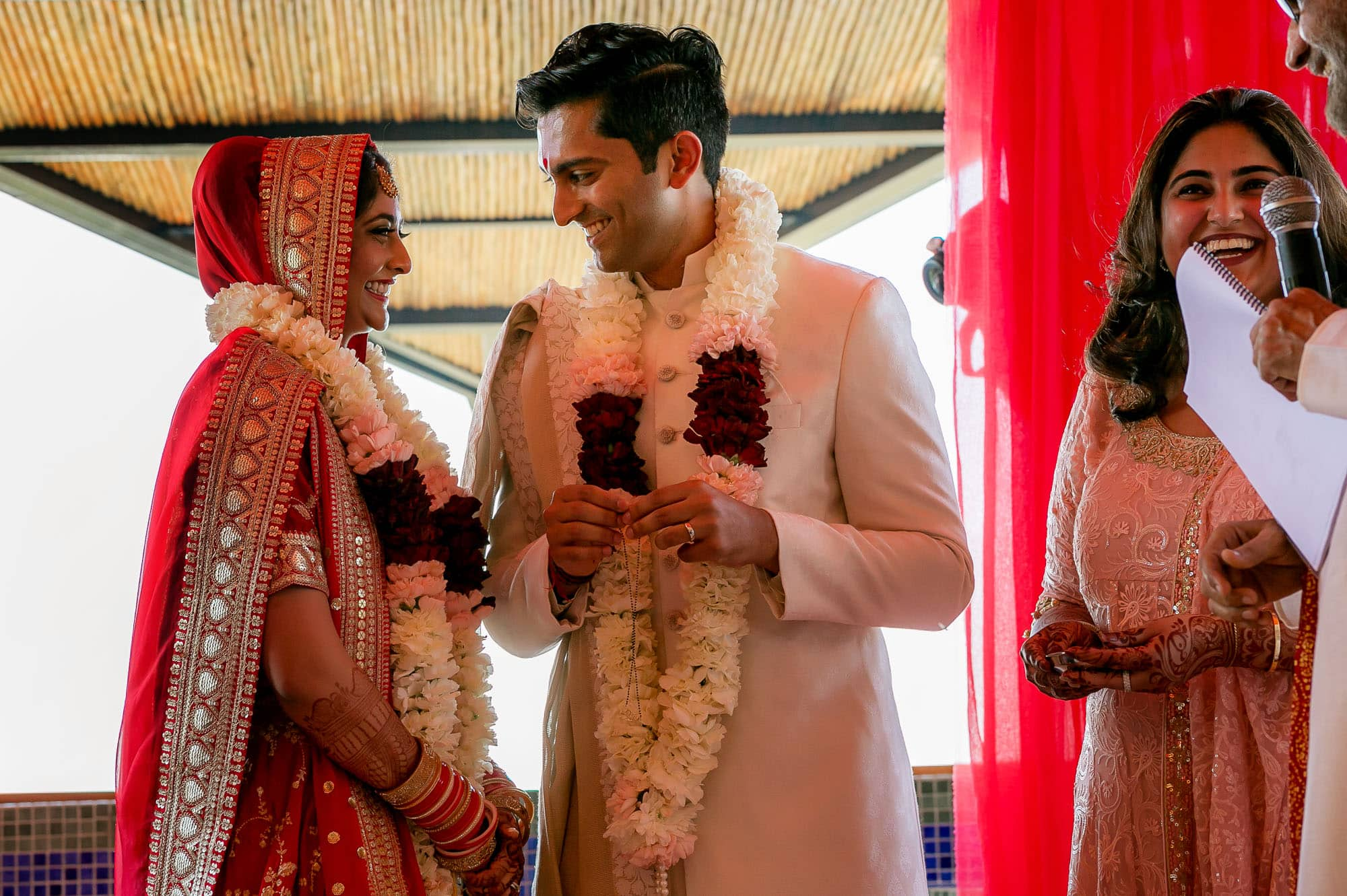 Exchanging rings at the traditional Hindu Muslim wedding ceremony