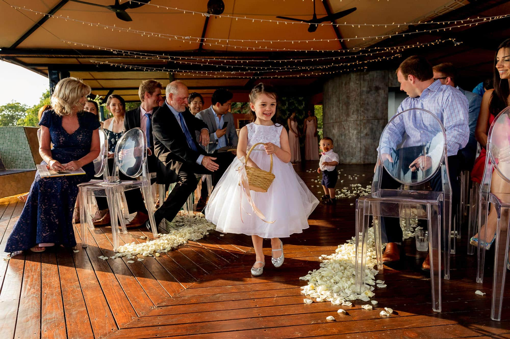 The flower girl comes down the aisle