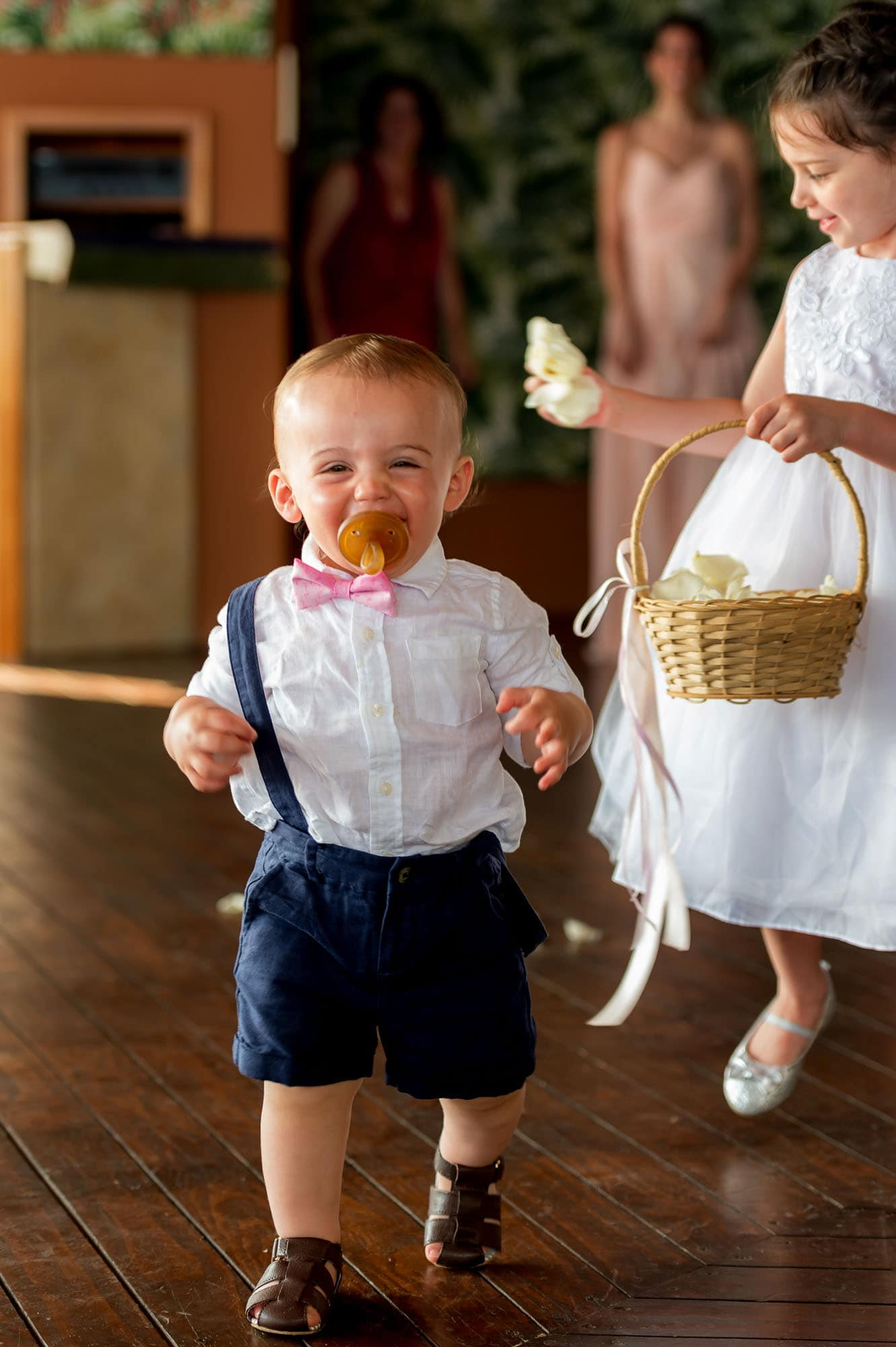 The adorable little ring bearer comes down the aisle