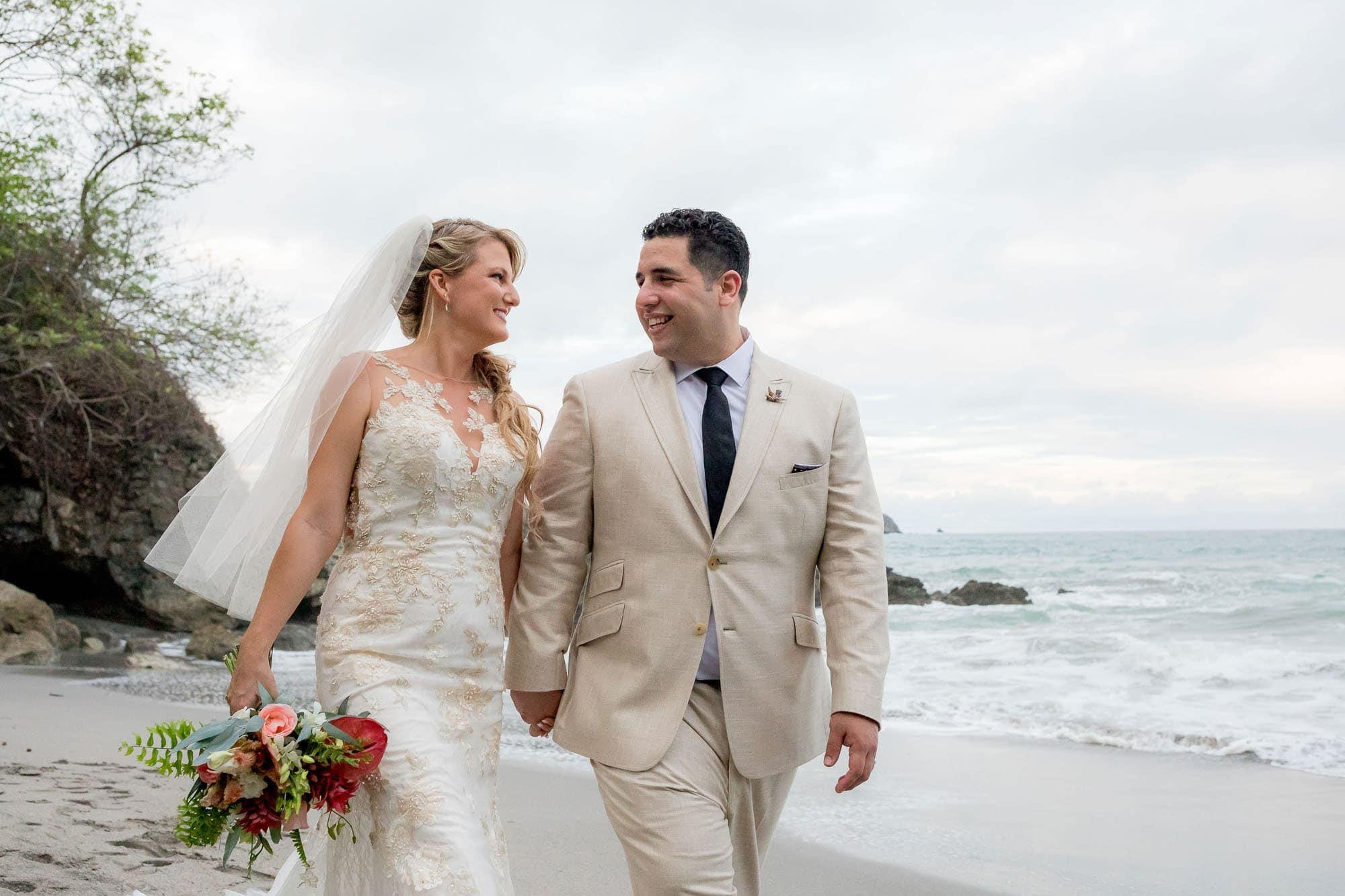 The bride and groom on the beach at Arenas del Mar
