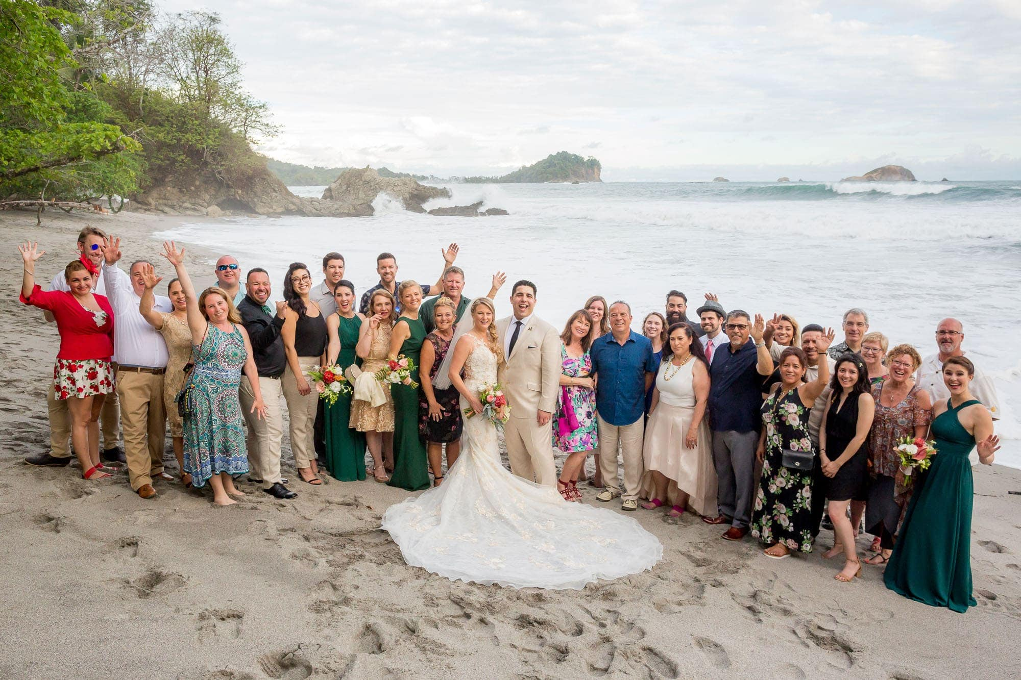 The happy group before the start of the beach wedding recepption